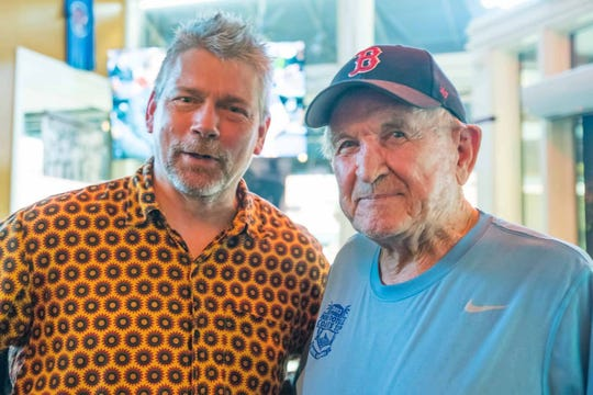 Scott West (left), owner of Preservation Pub and Tommy Trent's, poses at the latter with former UT football player and coach Johnny Majors in November 2018.