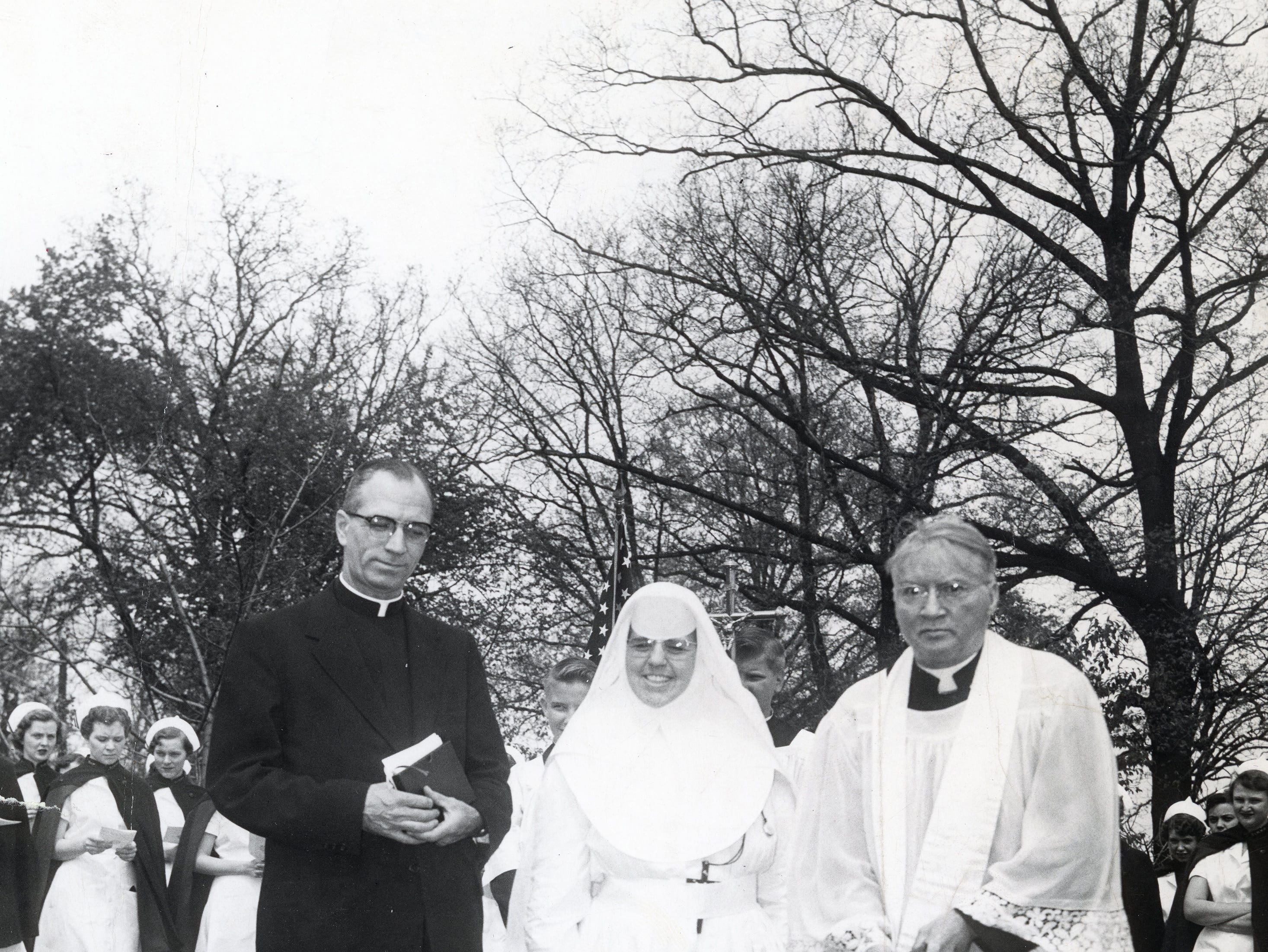 From left, Father Leo Baldinger, pastor of Holy Ghost Catholic Church, Sister Mary Annunciation, administrator of St. Mary's Memorial Hospital, and Father C.P. Wassem, chaplain of St. Mary's Medical Center in April 1955.