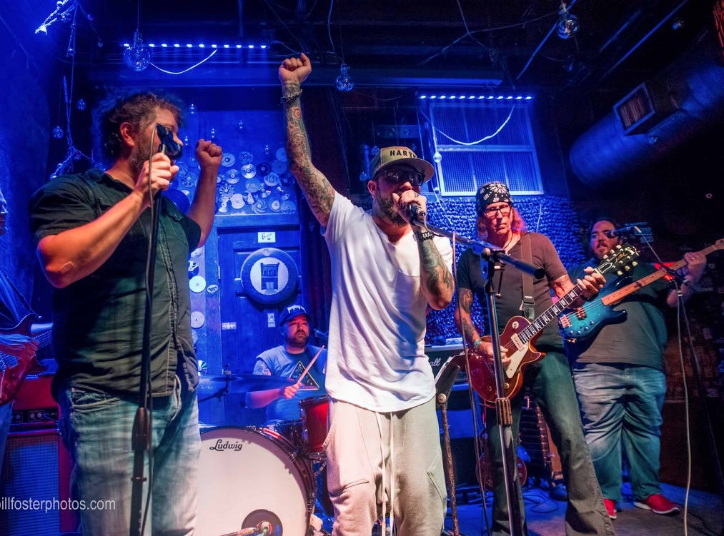 AJ McLean (center) of the Backstreet Boys performs with Badlands at Preservation Pub in Knoxville on June 29, 2018.