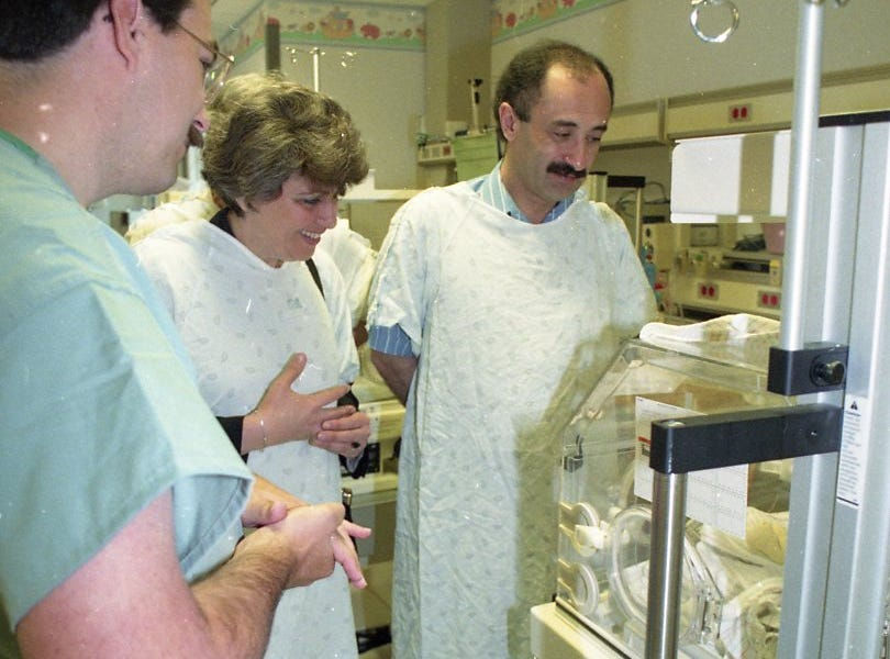 Three doctors from the Republic of Georgia visited St. Mary's Medical Center to observe American medical practices. St. Mary's neonatologist Pattrick Hodges explains to Nino Uznadze and George Nishniadze how the nurses intensive care unit operates in May 1993.