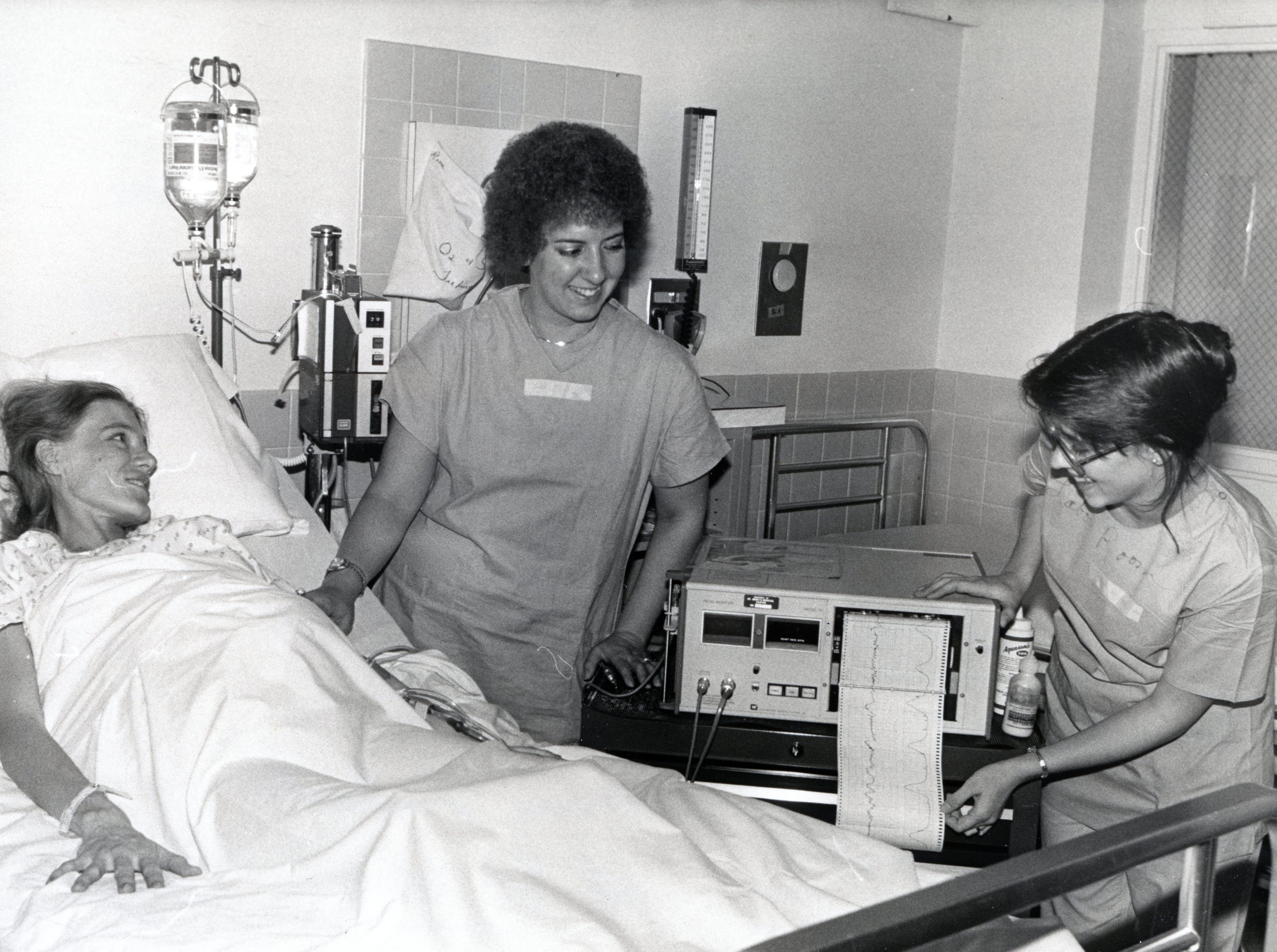 Nursing students Susan Col and Karen Lawson tend to patient Lydia Kiggins at St. Mary's Medical Center in January 1979.