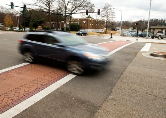 A car drives through the intersection of Volunteer Boulevard and Todd Helton Drive on the University of Tennessee's campus on Wednesday.