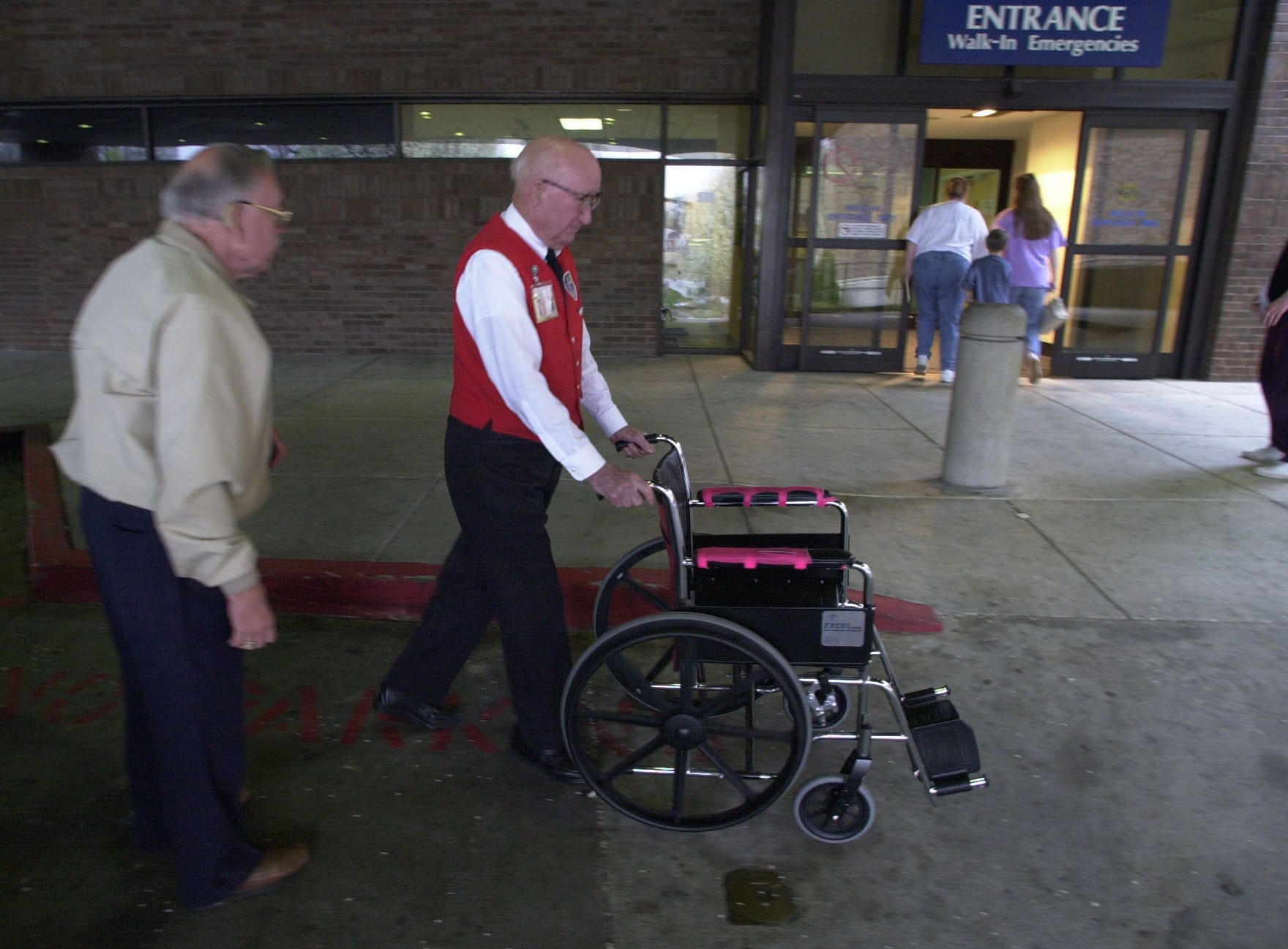 Otey Jones pushes an empty wheelchair back into the emergency room so nurses and paramedics could concentrate on the patient. Eighty-seven-year-old Jones has volunteered over 46,000 hours during the last 15 years at St. Mary's.