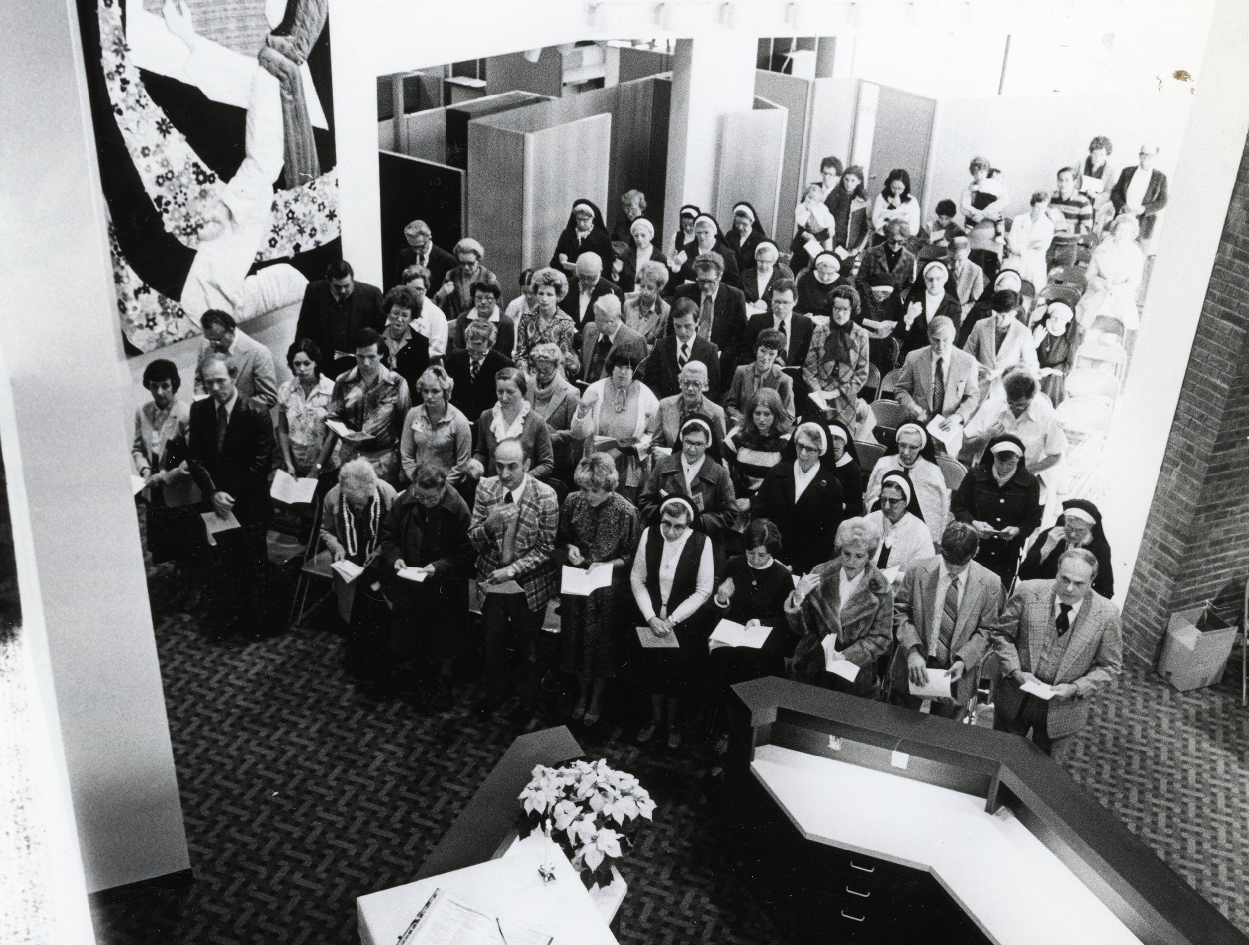 Bishop Niedergeses celebrates mass in the lobby of the new wing of St. Mary's Hospital before blessing the central wing in December 1979.