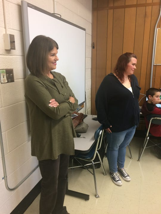 Knox County Schools board member Terry Hill, left, and Pleasant Ridge PTO president Samantha Singh watch the festivities of the opening of the technology room.