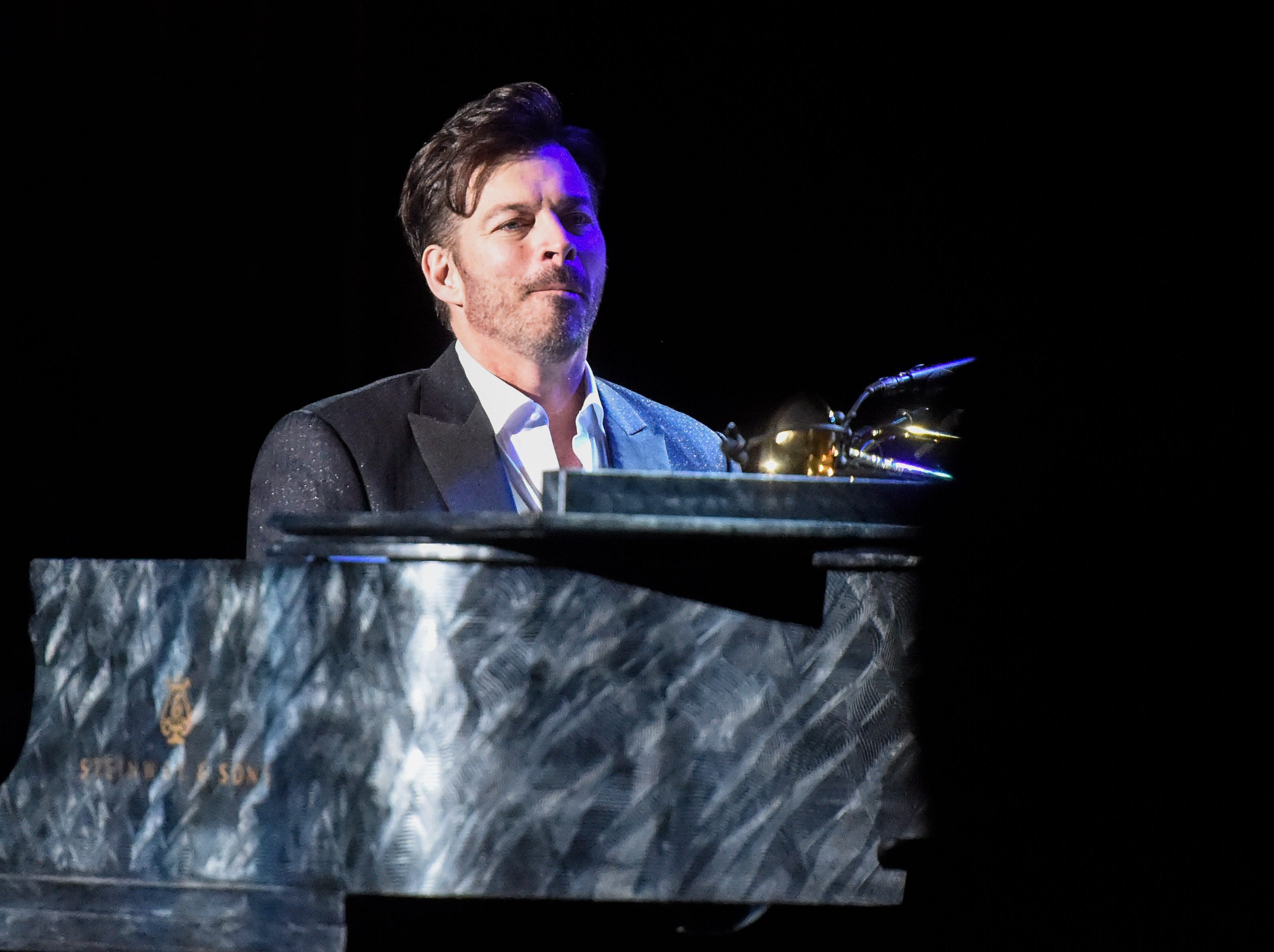 Harry Connick Jr. plays piano during his New Orleans Tricentennial Celebration at the Tennessee Theatre in Knoxville on Dec. 4, 2018.