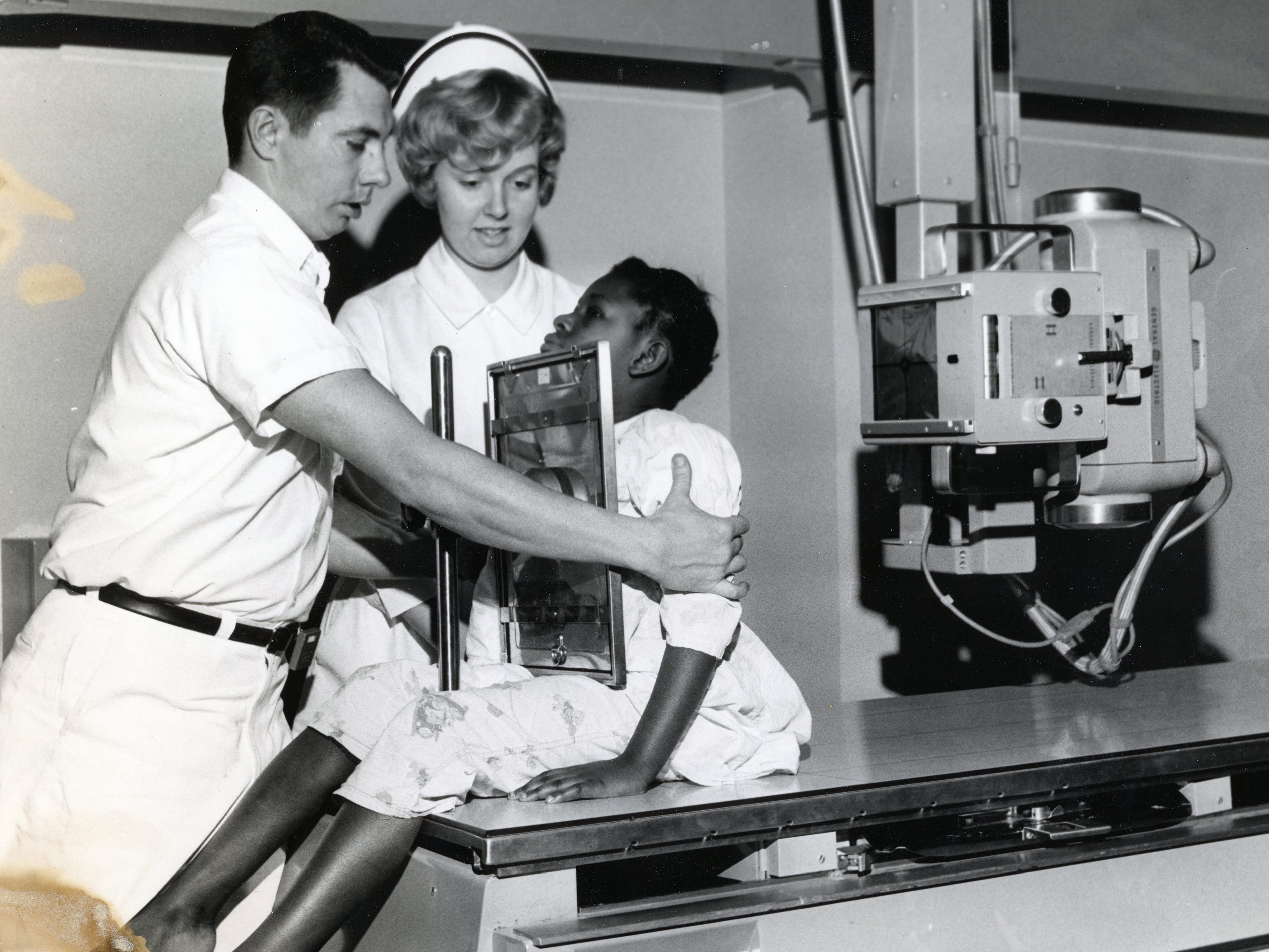 X-ray technologist Nick Slater and nurse Margaret Shanks work with patient Marilyn Duncan at St. Mary's Hospital in December 1966.