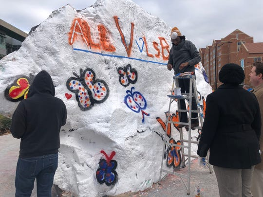 UT Knoxville faculty, staff and students paint the Rock on Wednesday, Dec. 5, 2018.