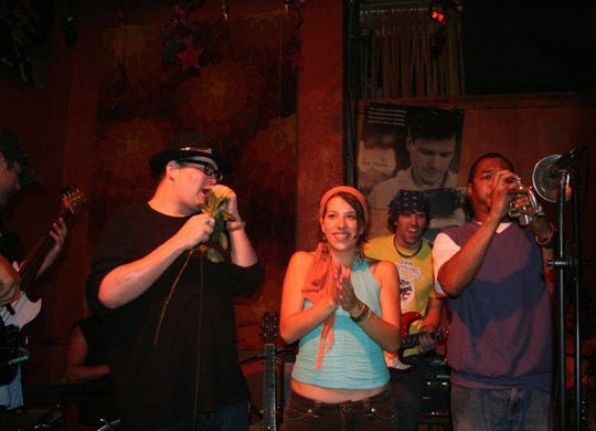 John Popper (left) of Blues Traveler gives an impromptu performance at Knoxville's Preservation Pub in 2010.
