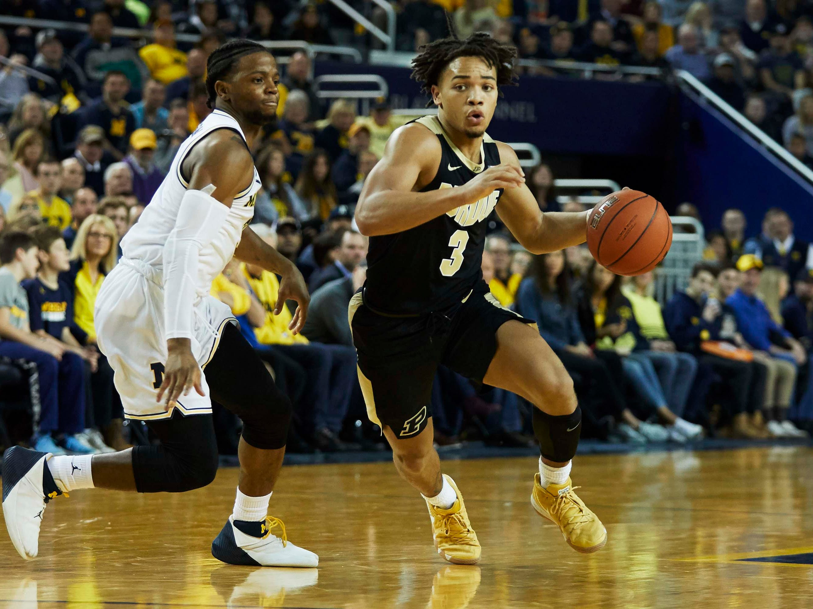 Dec 1, 2018; Ann Arbor, MI, USA; Purdue Boilermakers guard Carsen Edwards (3) dribbles on Michigan Wolverines guard Zavier Simpson (3) in the second half at Crisler Center. Mandatory Credit: Rick Osentoski-USA TODAY Sports