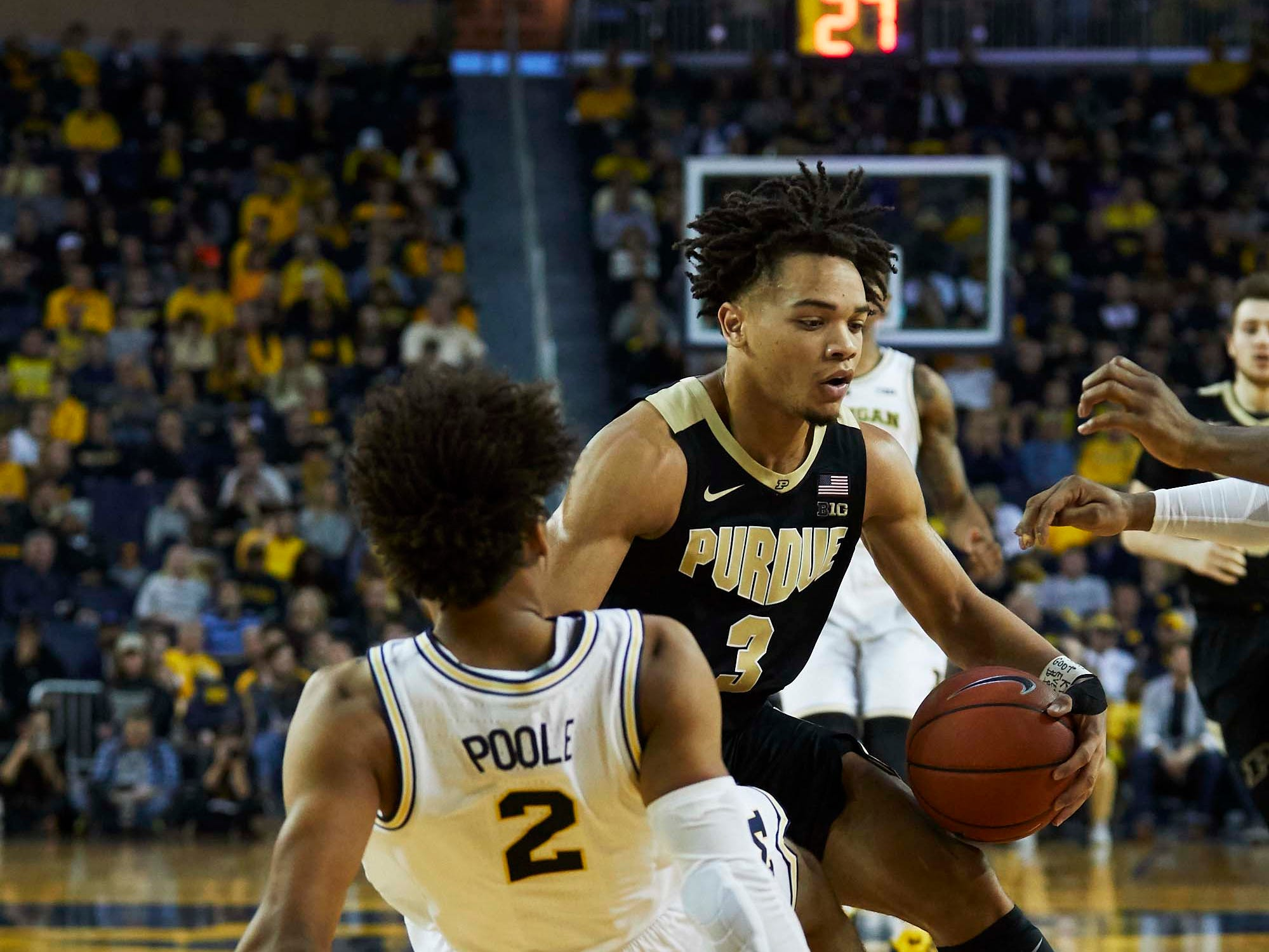 Dec 1, 2018; Ann Arbor, MI, USA; Purdue Boilermakers guard Carsen Edwards (3) charges Michigan Wolverines guard Jordan Poole (2) in the second half at Crisler Center. Mandatory Credit: Rick Osentoski-USA TODAY Sports