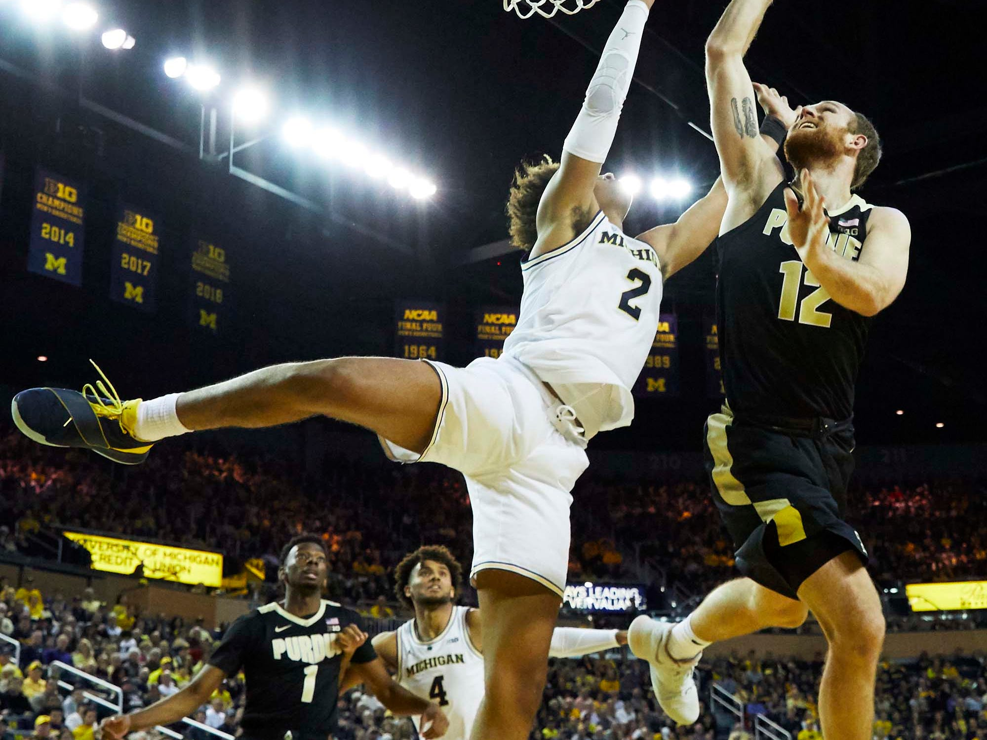 Dec 1, 2018; Ann Arbor, MI, USA; Purdue Boilermakers forward Evan Boudreaux (12) shoots on Michigan Wolverines guard Jordan Poole (2) in the second half at Crisler Center. Mandatory Credit: Rick Osentoski-USA TODAY Sports