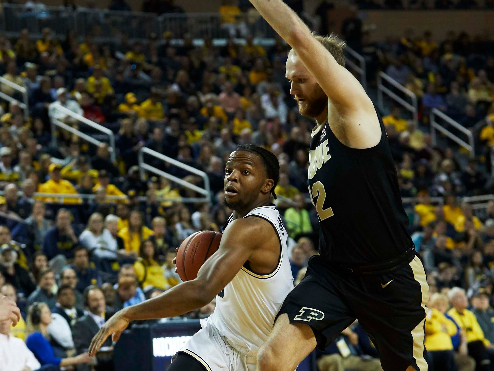 Dec 1, 2018; Ann Arbor, MI, USA; Michigan Wolverines guard Zavier Simpson (3) dribbles defended by Purdue Boilermakers forward Evan Boudreaux (12) in the first half at Crisler Center. Mandatory Credit: Rick Osentoski-USA TODAY Sports
