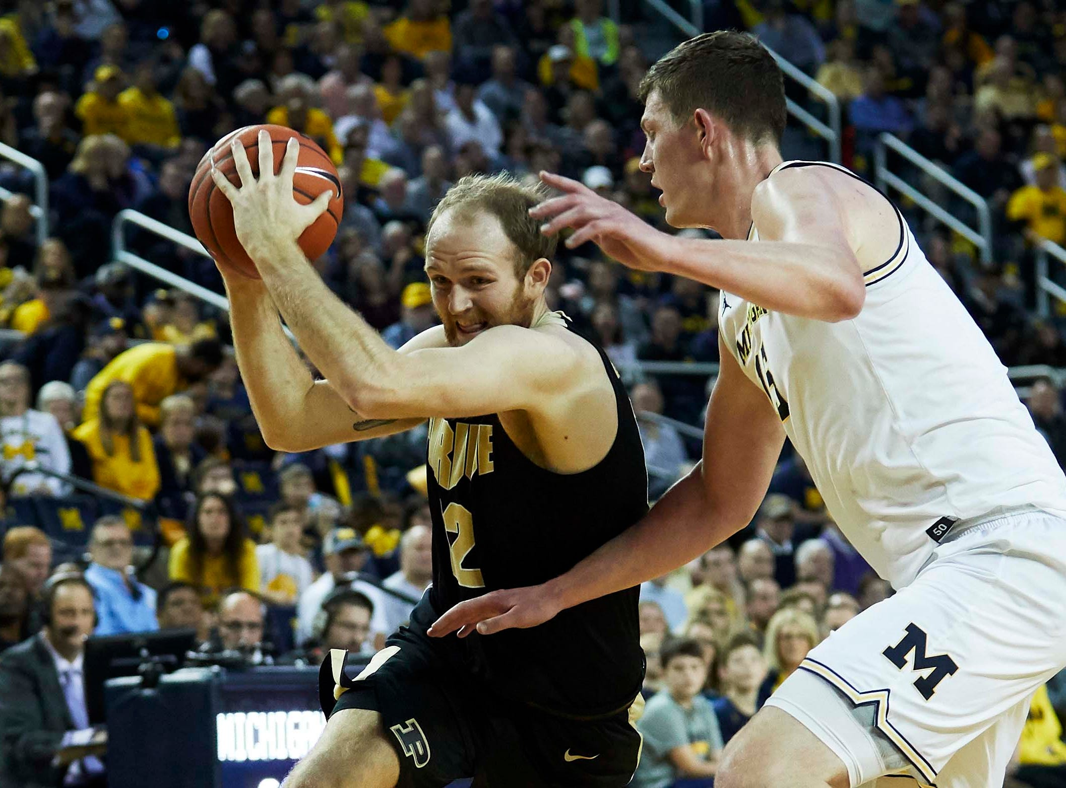 Dec 1, 2018; Ann Arbor, MI, USA; Purdue Boilermakers forward Evan Boudreaux (12) dribbles defended by Michigan Wolverines center Jon Teske (15) in the second half at Crisler Center. Mandatory Credit: Rick Osentoski-USA TODAY Sports
