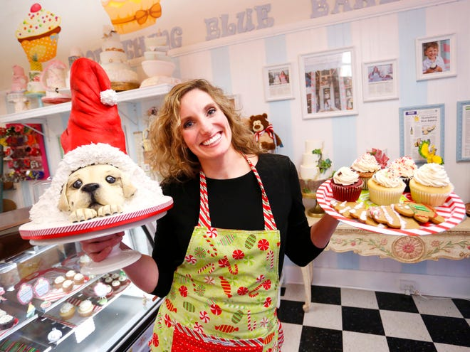 Makenzie Kus, owner/decorator of Something Blue Bakery, with delicious cupcakes, gingerbread men and a Santa puppy cake Wednesday, December 5, 2018, at 918 Main Street in Lafayette.