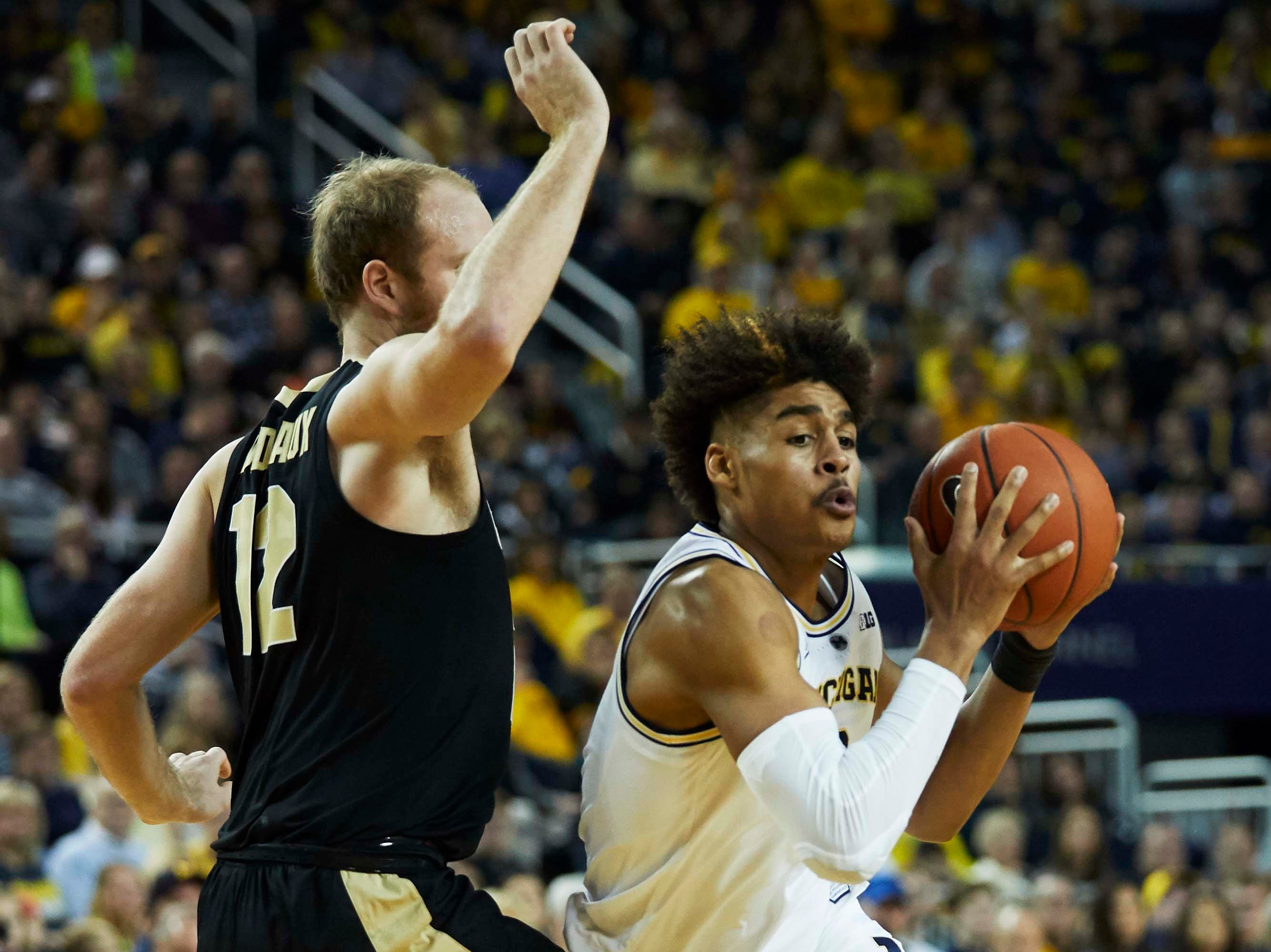 Dec 1, 2018; Ann Arbor, MI, USA; Michigan Wolverines guard Jordan Poole (2) moves the ball on Purdue Boilermakers forward Evan Boudreaux (12) in the first half at Crisler Center. Mandatory Credit: Rick Osentoski-USA TODAY Sports