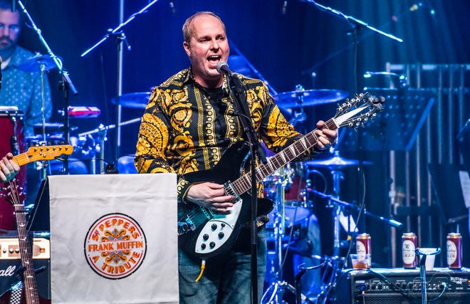 "Hans Rees, guitarist with Frank Muffin, performs in December 2017 as part of the Lafayette band's cover-to-cover tribute to the Beatles classic, ""Sgt. Pepper's Lonely Hearts Club Band."" On Dec. 8, the band will assemble a 19-piece orchestra to take on Pink Floyd's ""The Wall."""