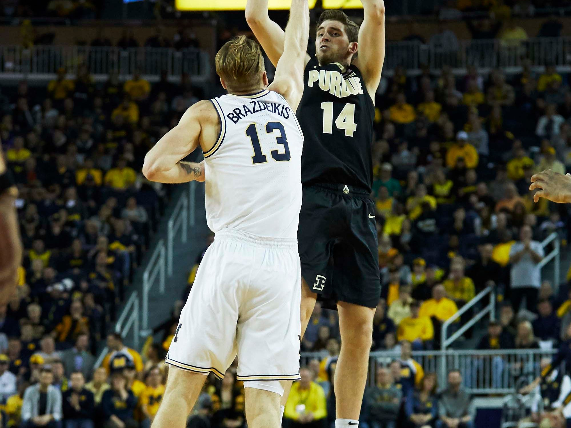 Dec 1, 2018; Ann Arbor, MI, USA; Purdue Boilermakers guard Ryan Cline (14) shoots on Michigan Wolverines forward Ignas Brazdeikis (13) in the second half at Crisler Center. Mandatory Credit: Rick Osentoski-USA TODAY Sports