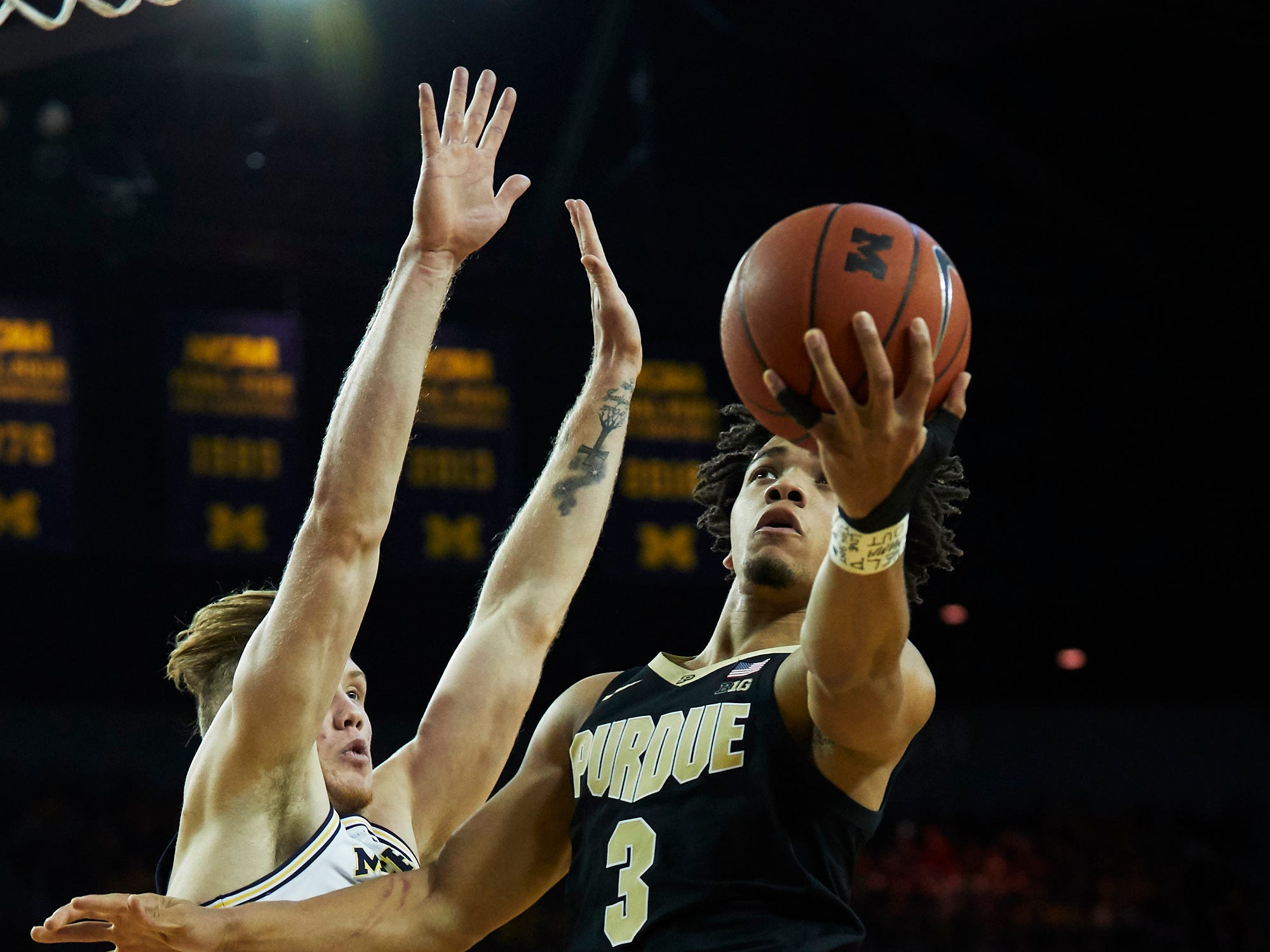 Dec 1, 2018; Ann Arbor, MI, USA; Purdue Boilermakers guard Carsen Edwards (3) shoots against Michigan Wolverines forward Ignas Brazdeikis (left) in the second half at Crisler Center. Mandatory Credit: Rick Osentoski-USA TODAY Sports