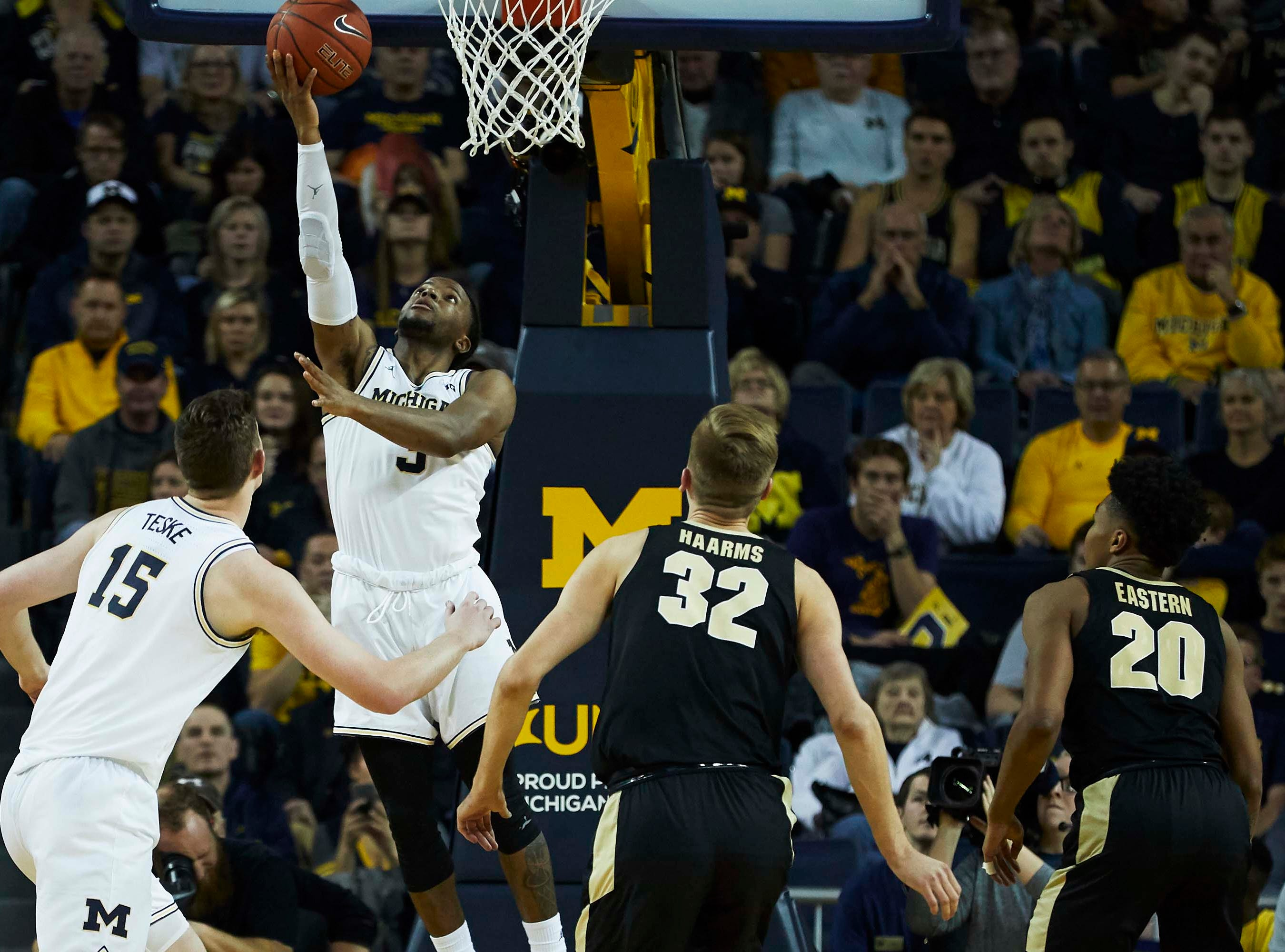 Dec 1, 2018; Ann Arbor, MI, USA; Michigan Wolverines guard Zavier Simpson (3) shoots in the second half against the Purdue Boilermakers at Crisler Center. Mandatory Credit: Rick Osentoski-USA TODAY Sports