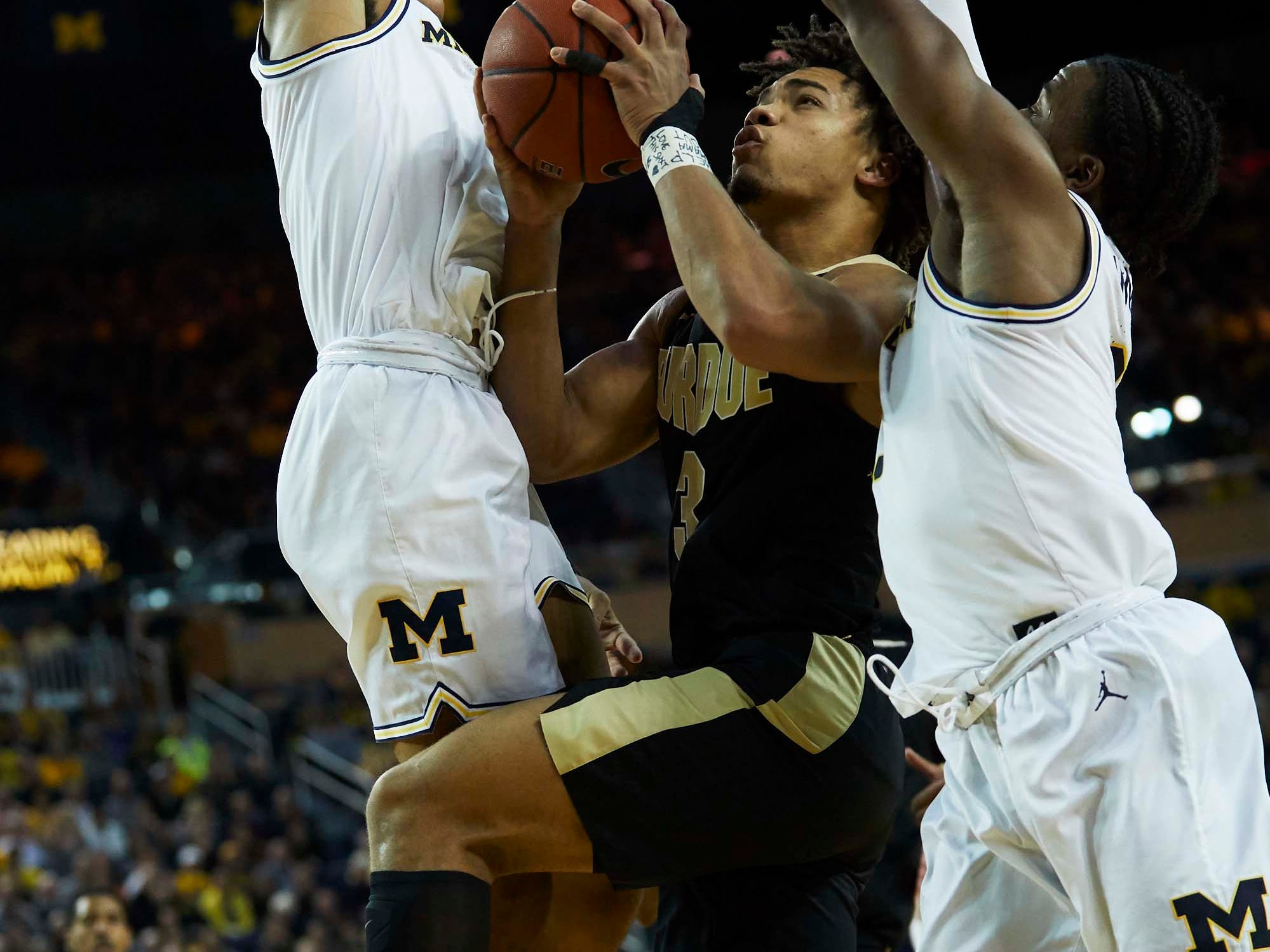 Dec 1, 2018; Ann Arbor, MI, USA; Michigan Wolverines guard Jordan Poole (2) goes to the basket defended by Michigan Wolverines guard Jordan Poole (left) and guard Zavier Simpson (right) in the second half at Crisler Center. Mandatory Credit: Rick Osentoski-USA TODAY Sports
