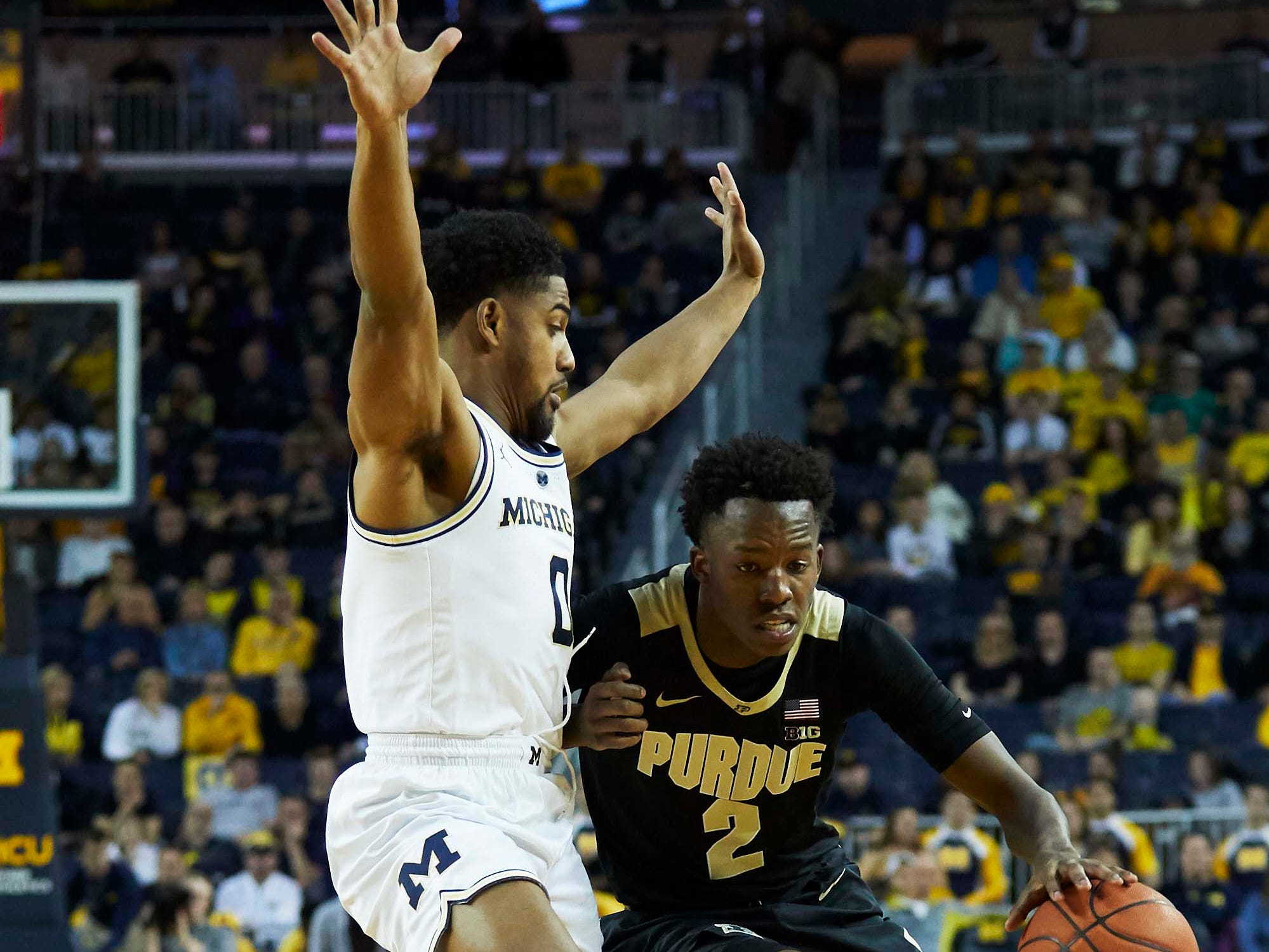 Dec 1, 2018; Ann Arbor, MI, USA; Purdue Boilermakers guard Eric Hunter Jr. (2) dribbles defended by Michigan Wolverines guard David DeJulius (0) in the second half at Crisler Center. Mandatory Credit: Rick Osentoski-USA TODAY Sports