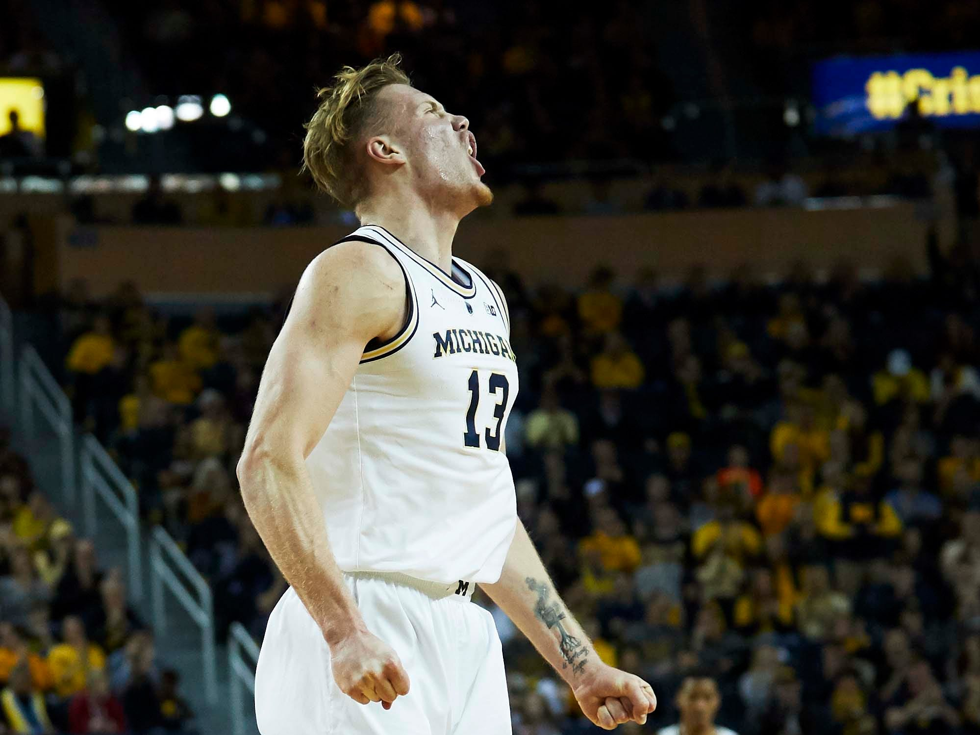 Dec 1, 2018; Ann Arbor, MI, USA; Michigan Wolverines forward Ignas Brazdeikis (13) celebrates after he dunks in the first half against the Purdue Boilermakers at Crisler Center. Mandatory Credit: Rick Osentoski-USA TODAY Sports