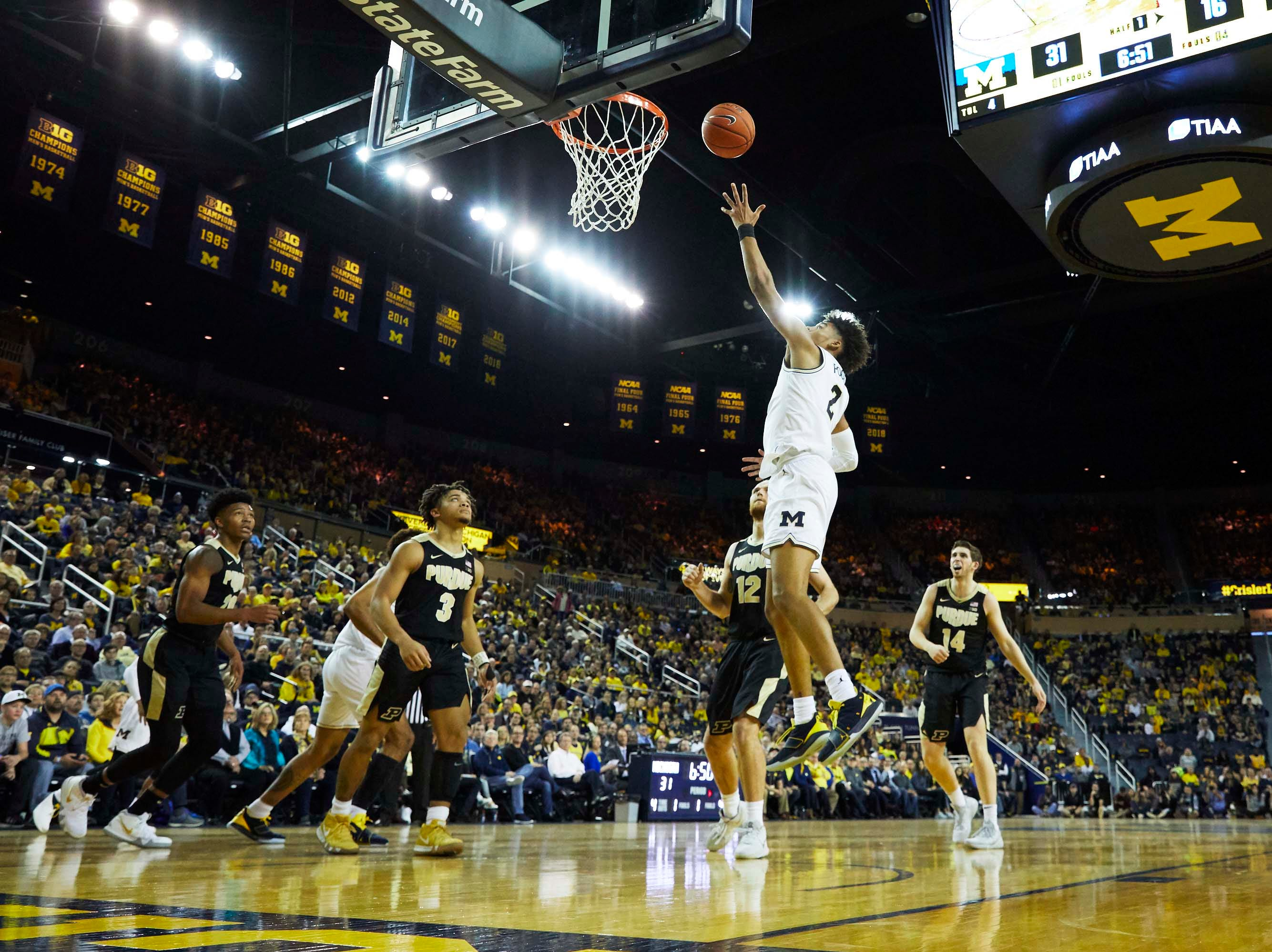 Dec 1, 2018; Ann Arbor, MI, USA; Michigan Wolverines guard Jordan Poole (2) shoots in the first half against the Purdue Boilermakers at Crisler Center. Mandatory Credit: Rick Osentoski-USA TODAY Sports