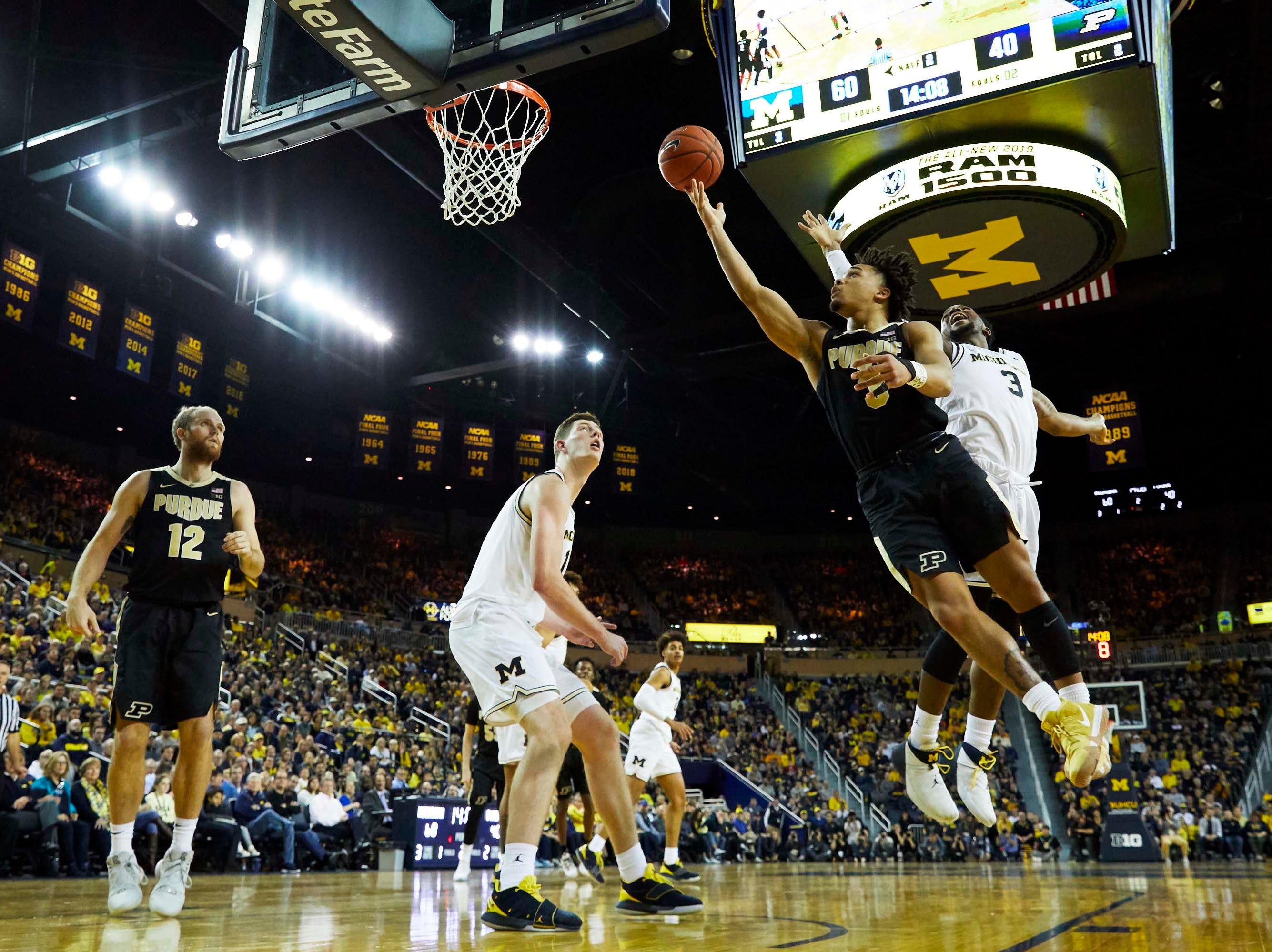 Dec 1, 2018; Ann Arbor, MI, USA; Purdue Boilermakers guard Carsen Edwards (3) shoots on Michigan Wolverines guard Zavier Simpson (3) in the second half at Crisler Center. Mandatory Credit: Rick Osentoski-USA TODAY Sports