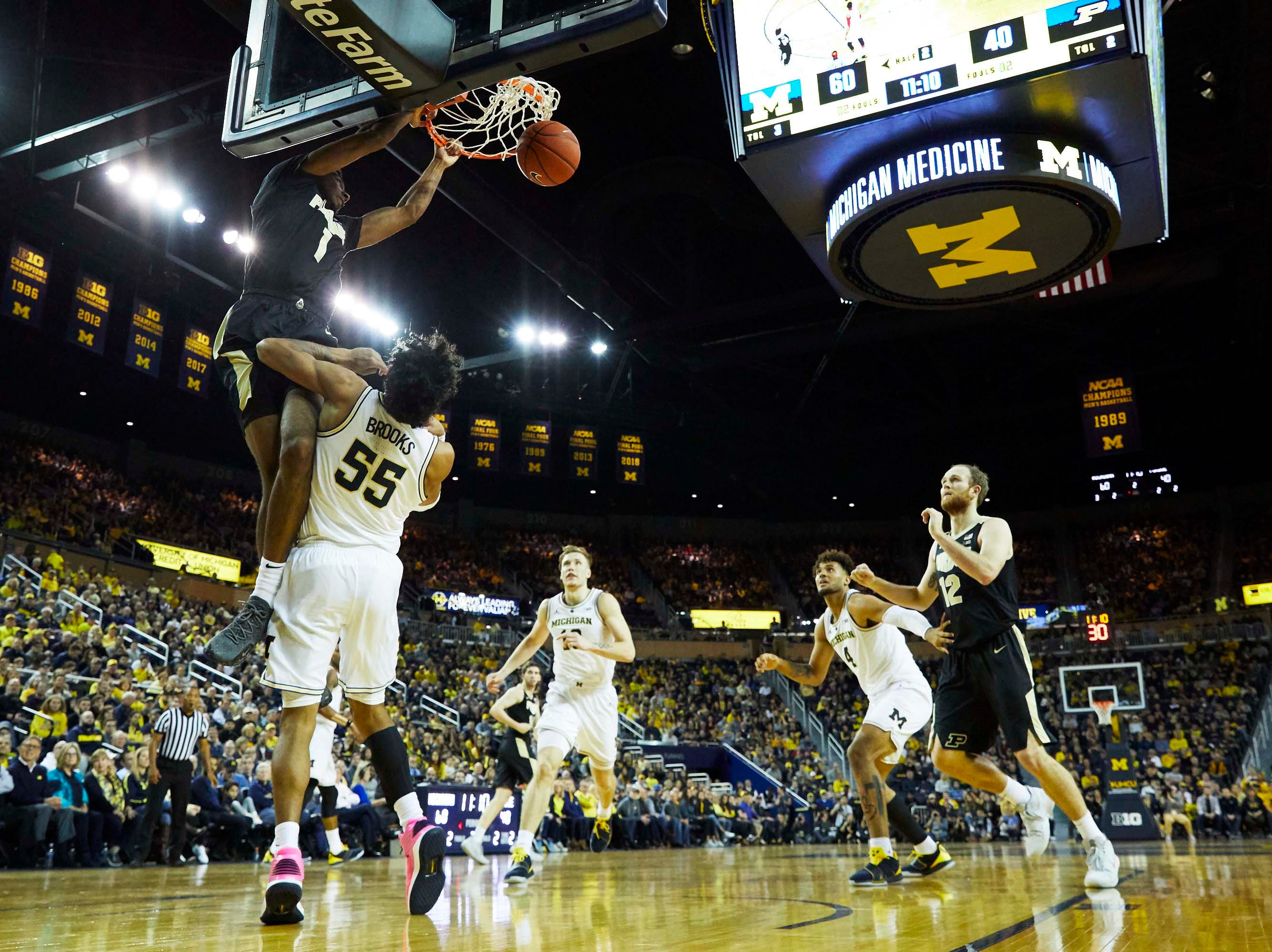 Dec 1, 2018; Ann Arbor, MI, USA; Purdue Boilermakers forward Aaron Wheeler (1) dunks on Michigan Wolverines guard Eli Brooks (55) in the second half at Crisler Center. Mandatory Credit: Rick Osentoski-USA TODAY Sports