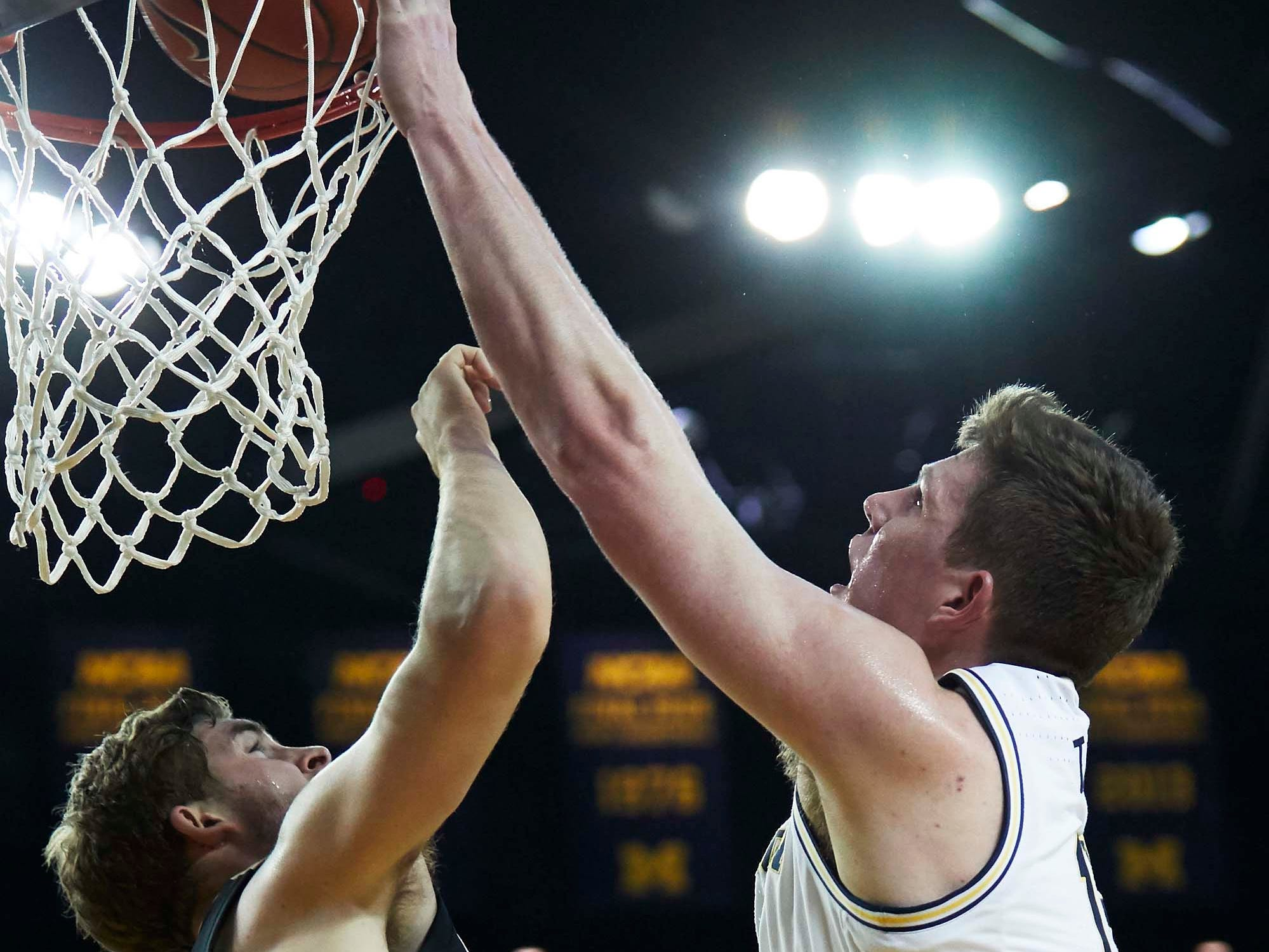 Dec 1, 2018; Ann Arbor, MI, USA; Michigan Wolverines center Jon Teske (15) shoots on Purdue Boilermakers guard Ryan Cline (14) in the first half at Crisler Center. Mandatory Credit: Rick Osentoski-USA TODAY Sports