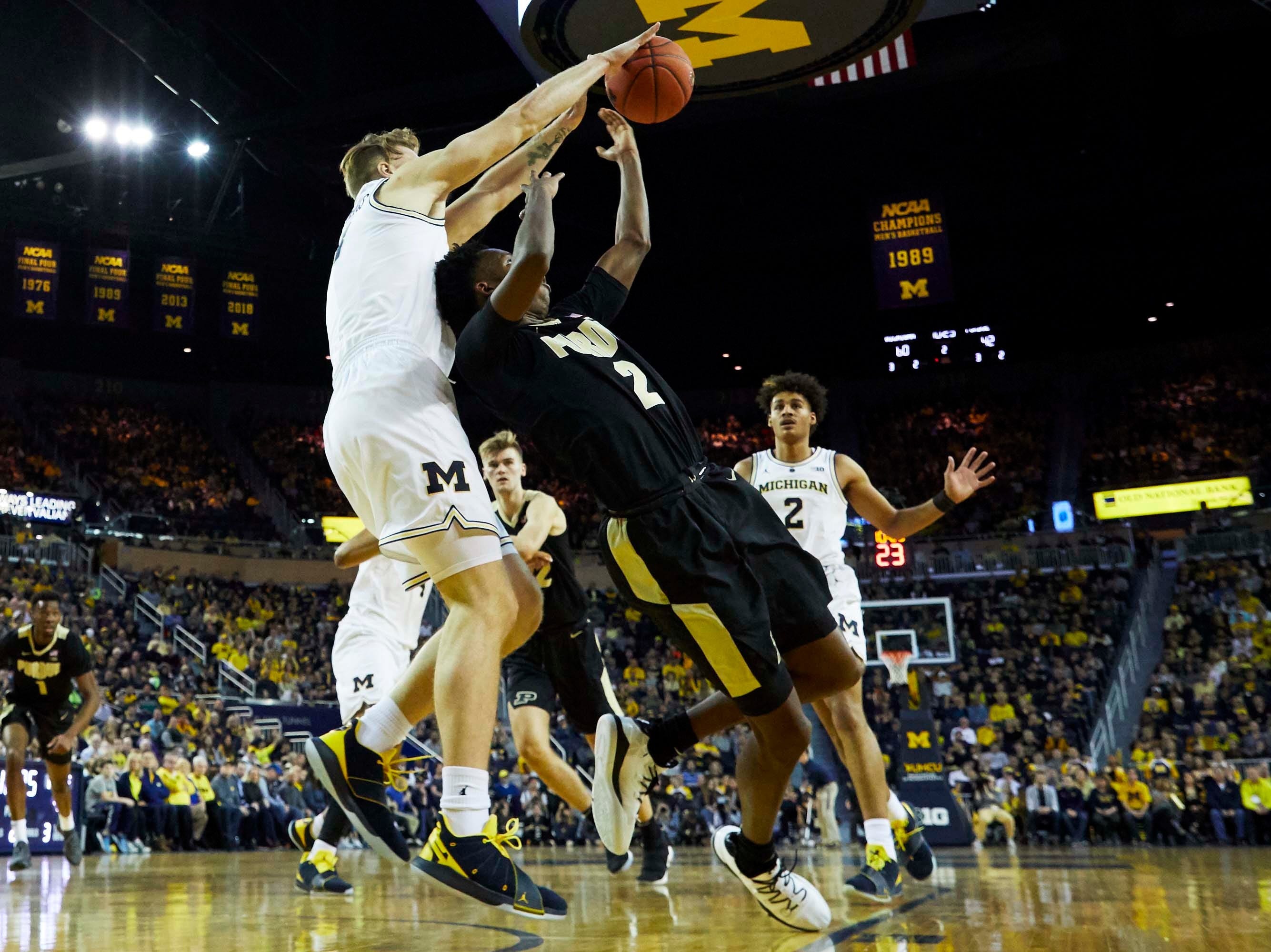 Dec 1, 2018; Ann Arbor, MI, USA; Michigan Wolverines forward Ignas Brazdeikis (13) blocks a shot by Purdue Boilermakers guard Eric Hunter Jr. (2) in the second half at Crisler Center. Mandatory Credit: Rick Osentoski-USA TODAY Sports
