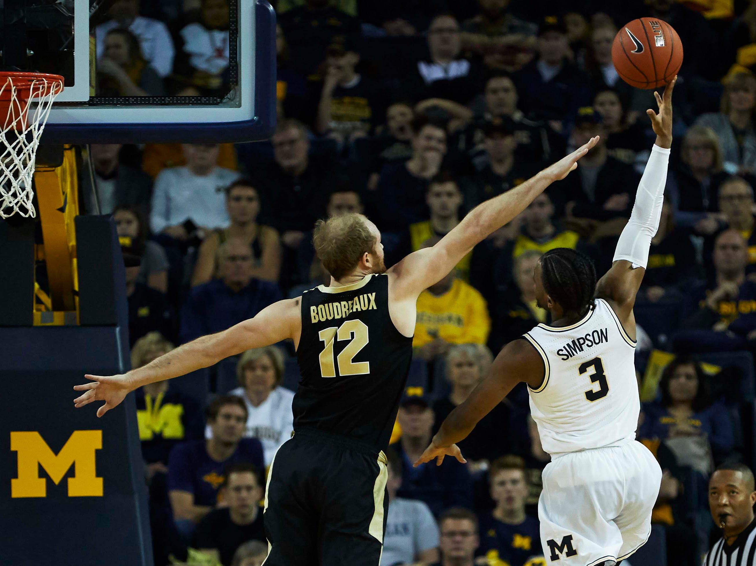 Dec 1, 2018; Ann Arbor, MI, USA; Michigan Wolverines guard Zavier Simpson (3) shoots on Purdue Boilermakers forward Evan Boudreaux (12) in the second half at Crisler Center. Mandatory Credit: Rick Osentoski-USA TODAY Sports