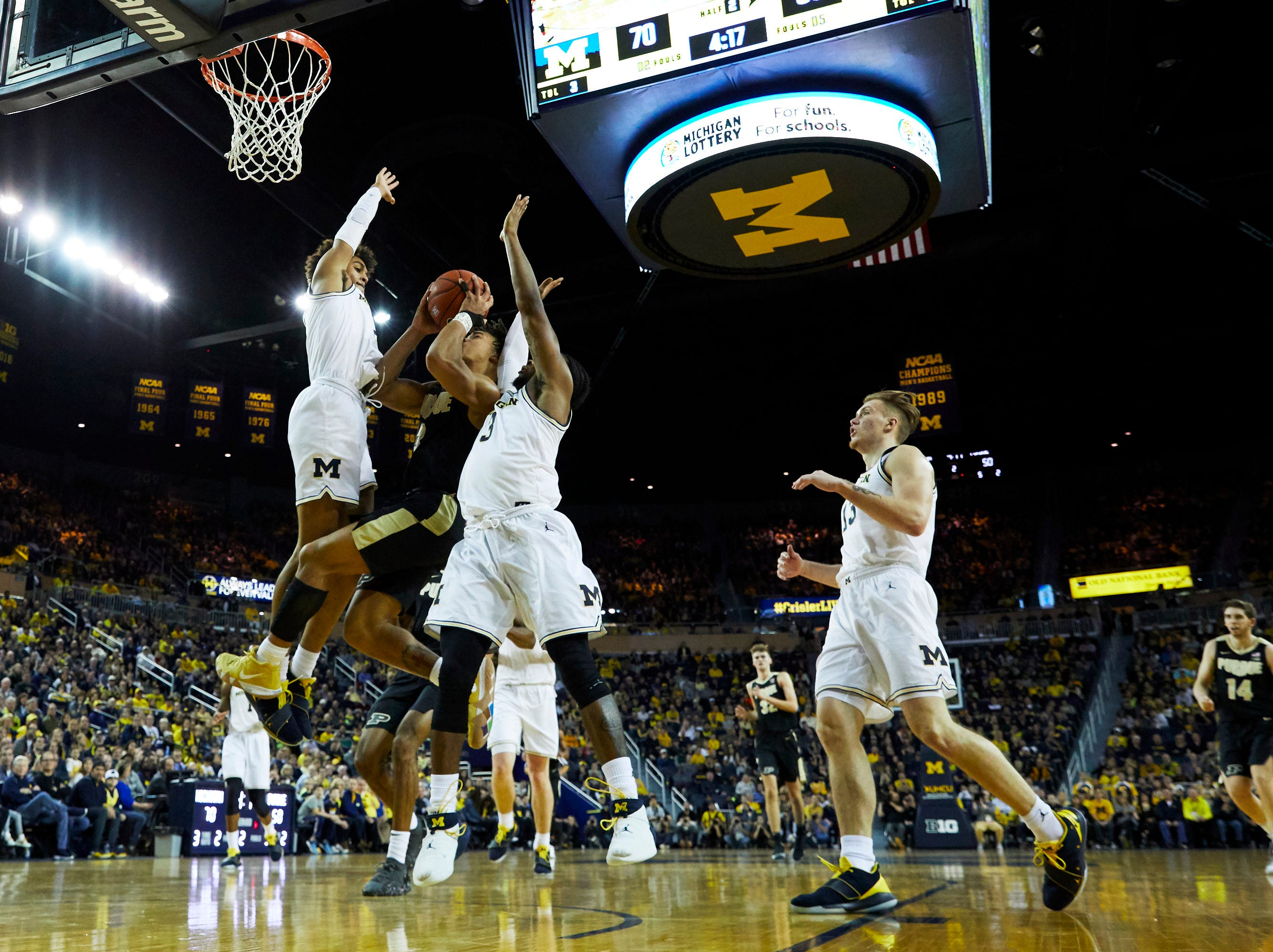 Dec 1, 2018; Ann Arbor, MI, USA; Michigan Wolverines guard Jordan Poole (2) drives  to the basket against Michigan Wolverines guard Jordan Poole (left) and guard Zavier Simpson (right) in the second half at Crisler Center. Mandatory Credit: Rick Osentoski-USA TODAY Sports