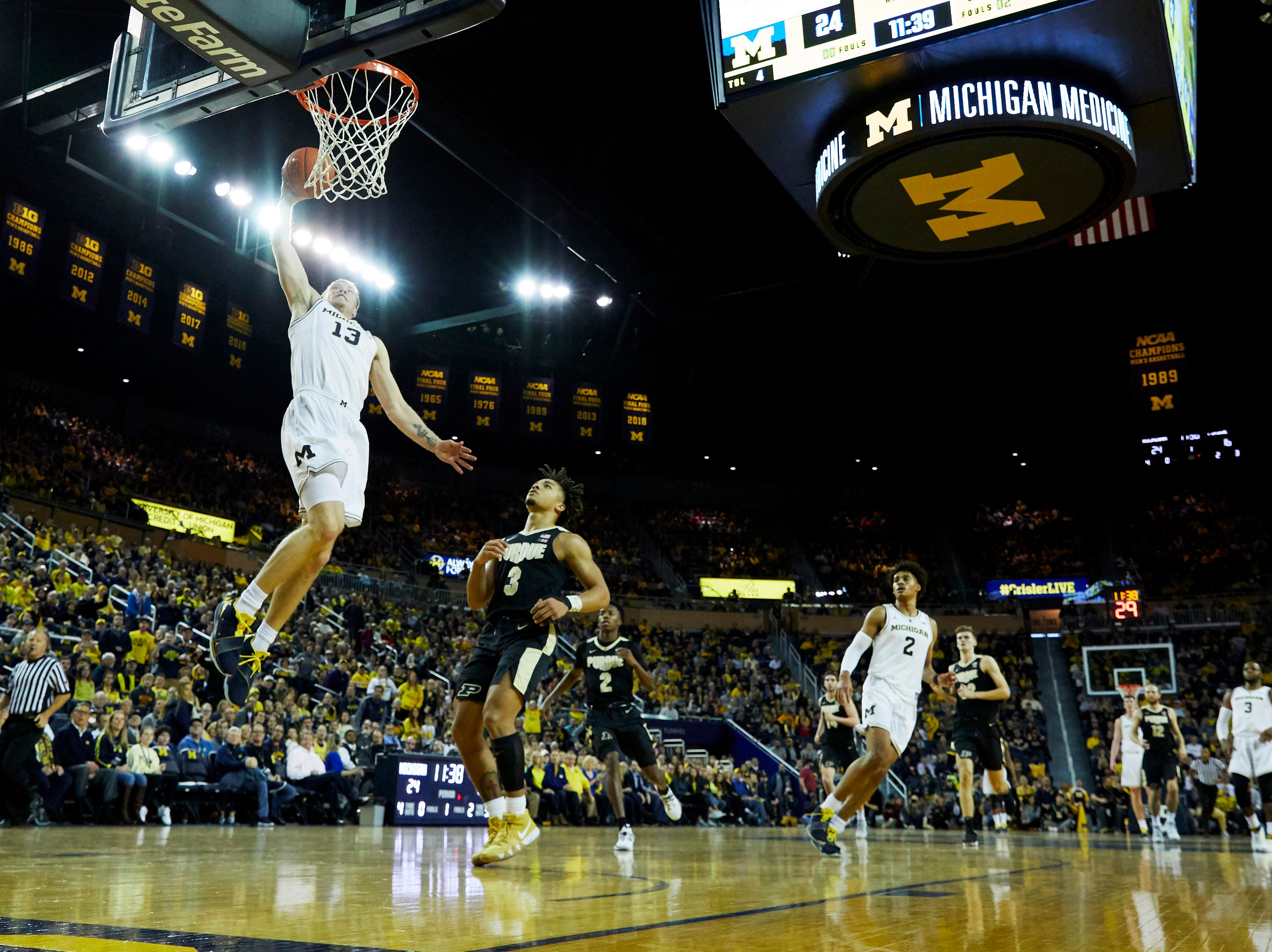 Dec 1, 2018; Ann Arbor, MI, USA; Michigan Wolverines forward Ignas Brazdeikis (13) dunks in the first half against the Purdue Boilermakers at Crisler Center. Mandatory Credit: Rick Osentoski-USA TODAY Sports