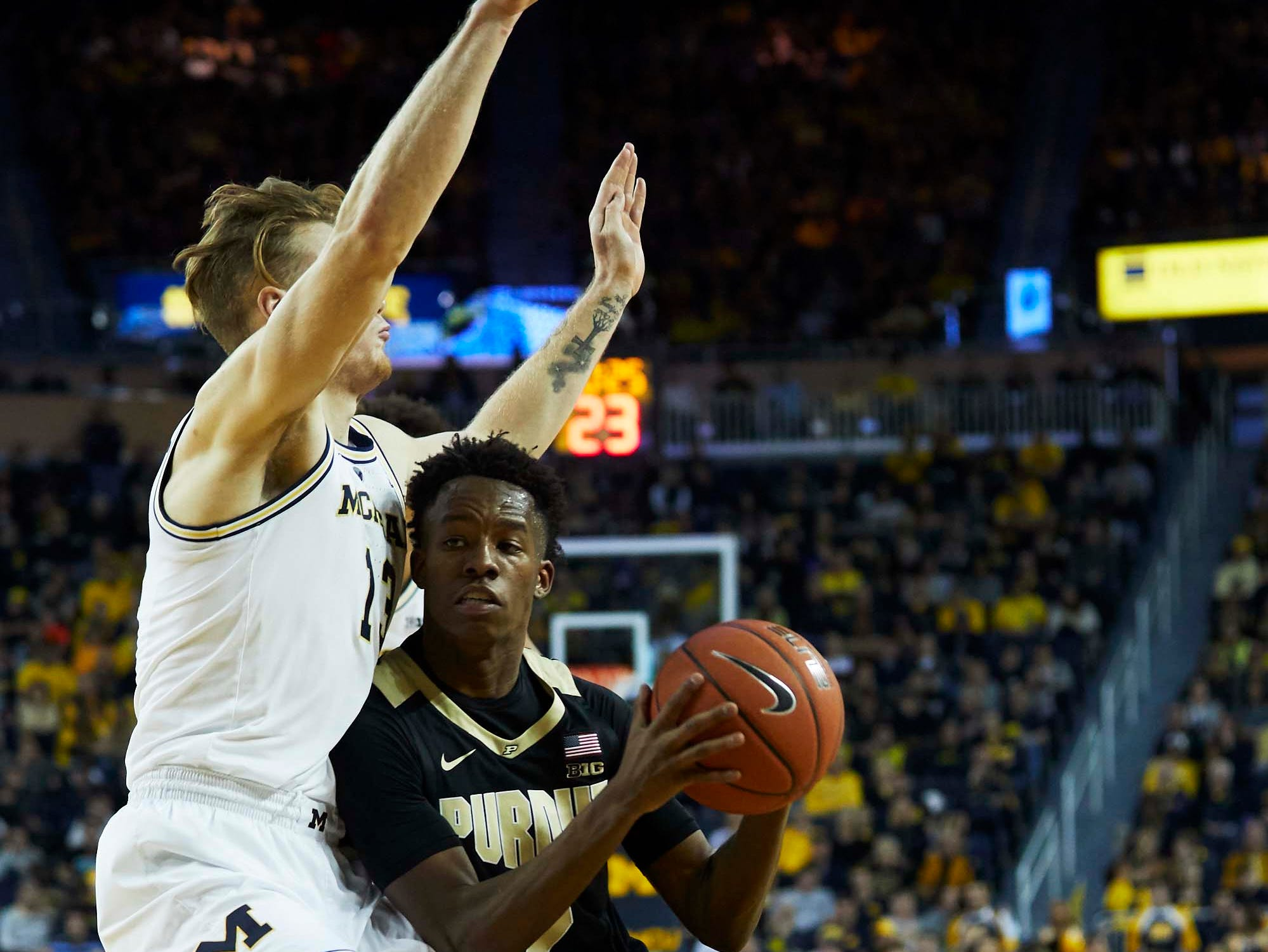 Dec 1, 2018; Ann Arbor, MI, USA; Purdue Boilermakers guard Eric Hunter Jr. (2) dribbles defended by Michigan Wolverines forward Ignas Brazdeikis (13) in the second half at Crisler Center. Mandatory Credit: Rick Osentoski-USA TODAY Sports
