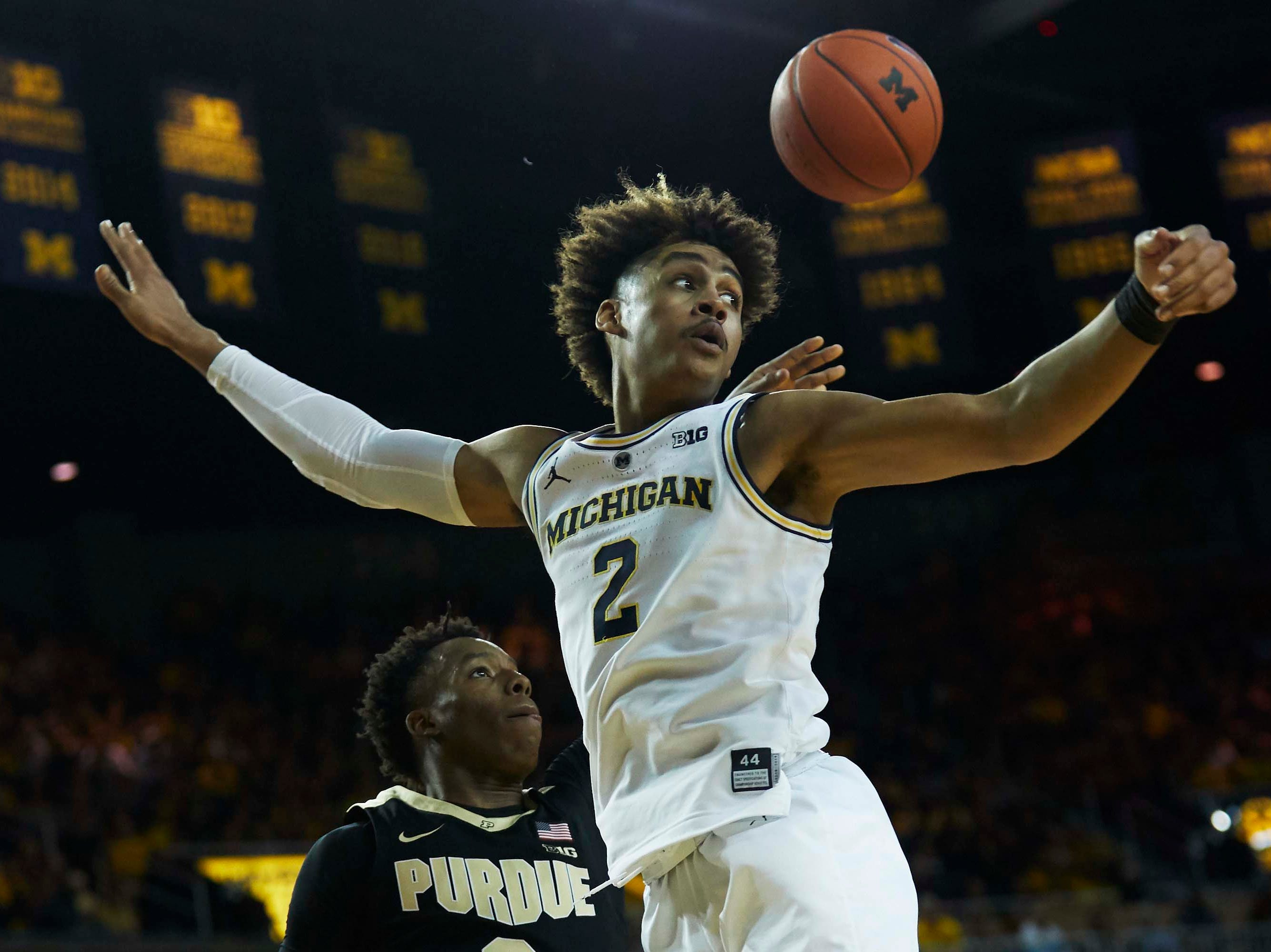 Dec 1, 2018; Ann Arbor, MI, USA; Purdue Boilermakers guard Eric Hunter Jr. (2) passes around Michigan Wolverines guard Jordan Poole (2) in the second half at Crisler Center. Mandatory Credit: Rick Osentoski-USA TODAY Sports