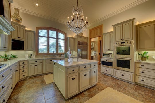 The kitchen has been redone in designer colors and amenities.
