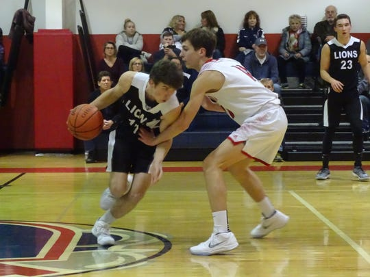 Fairfield Christian Academy freshman Jared Rose guards Granville Christian academy's Thomas Benvie during a nonconference game Tuesday night.