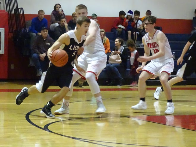 Granville Christian Academy's Nick Wilford dribbles past Fairfield Christian Academy's Blaine Keener and Jayden Akers during a nonconference game Tuesday night. The Knights won, 67-32.