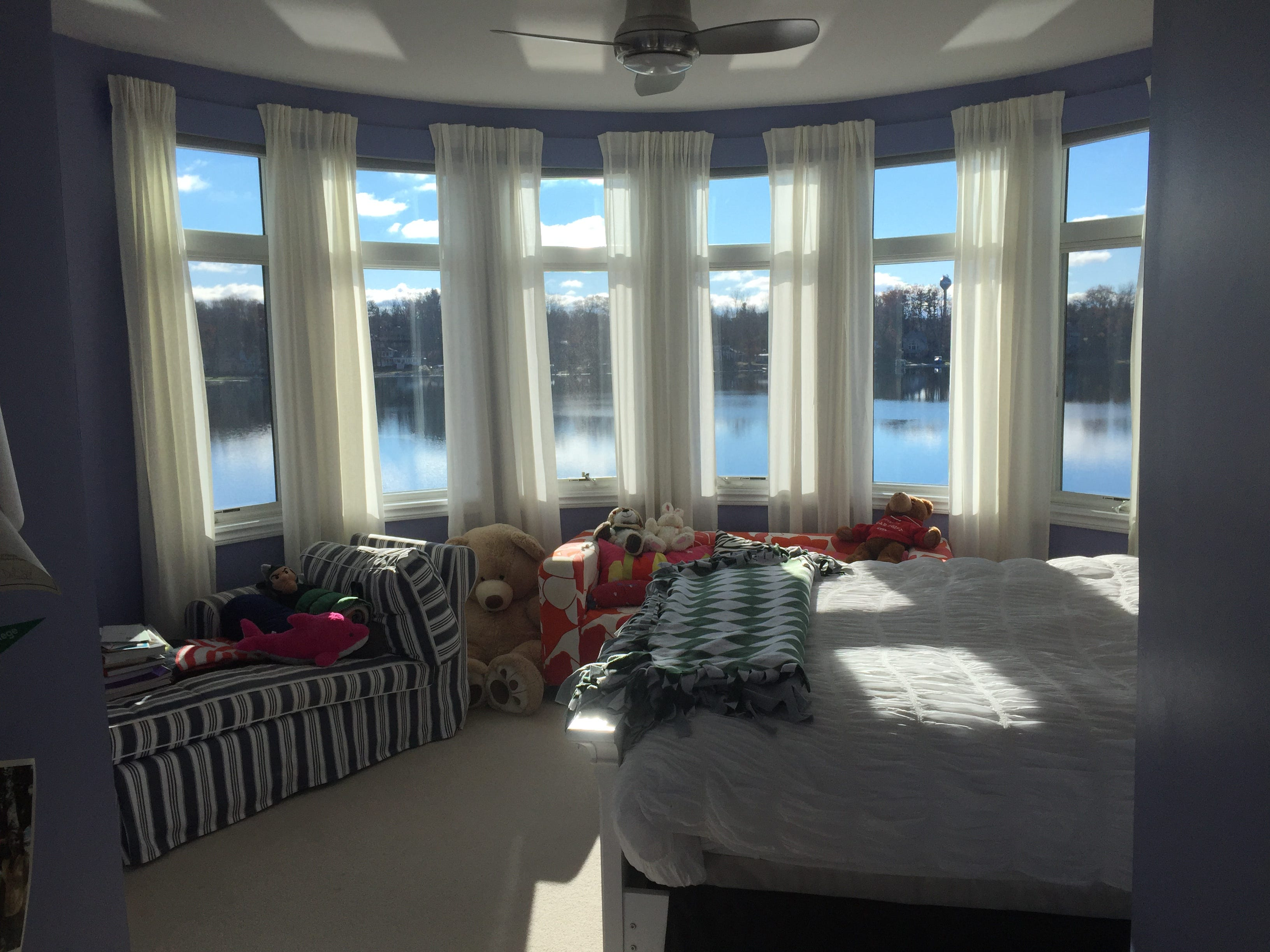 A rounded wall of windows overlooking a lake are a unique feature of a child's bedroom in a Clifford Road home in Genoa Township, shown Tuesday, Dec. 4, 2018
