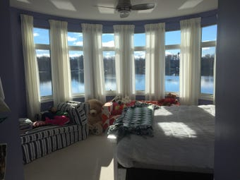 Dozens of large windows and balconies in a Clifford Road lake home in Genoa Township provide beautiful views of the lake from virtually every room.
