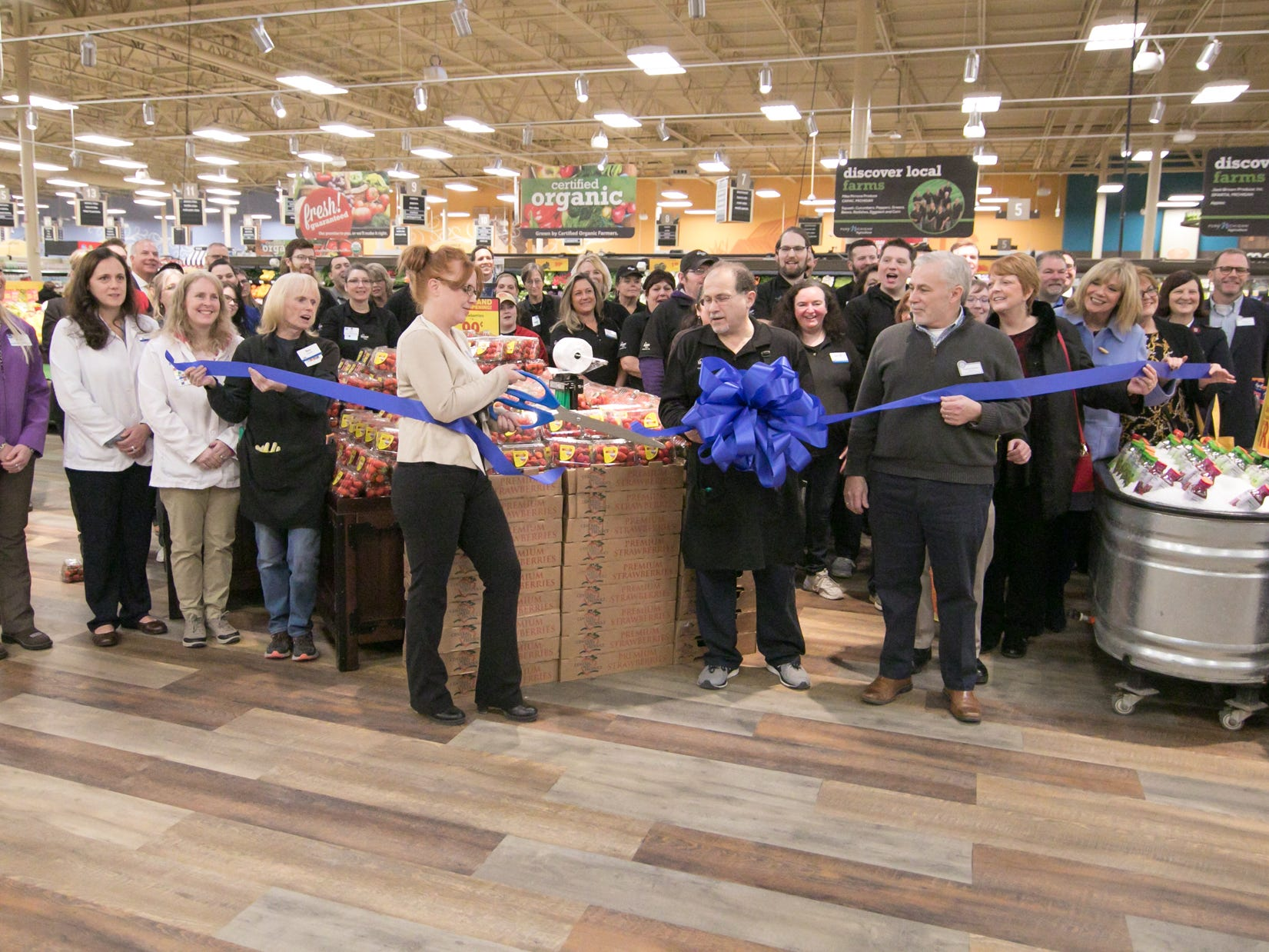 Brighton Kroger store manager Shannon Prieur cuts a ribbon at the expansion celebration of the grocery store Wednesday, Dec. 5, 2018.