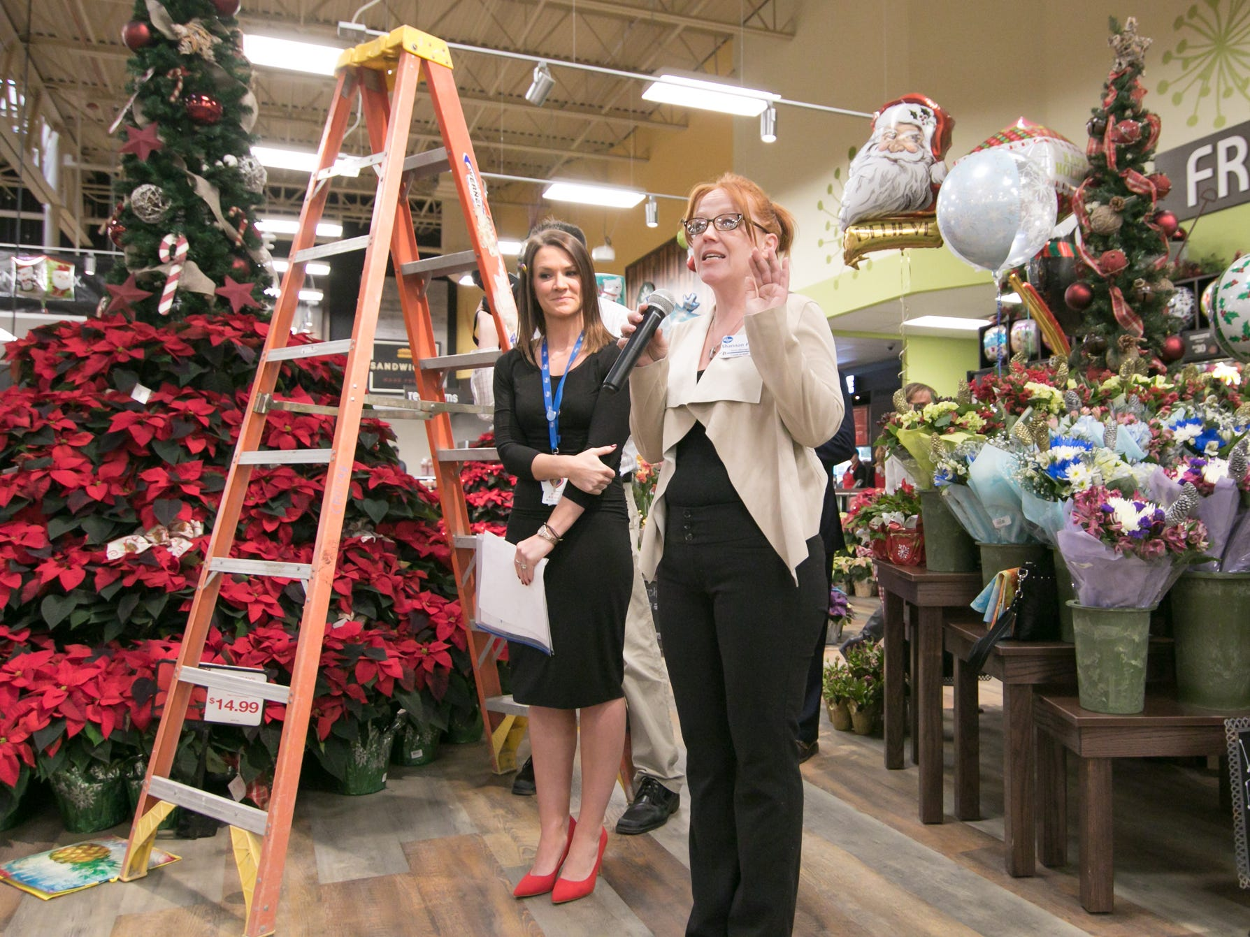 Brighton Kroger store manager Shannon Prieur, right, talks at the store's expansion celebration Wednesday, Dec. 5, 2018, with Kroger Co. of Michigan corporate affairs manager Rachel Hurst listening.