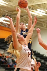 Hartland's Madi Moyer takes a shot over Fenton's Chloe Idoni during the Eagles' 61-37 victory on Tuesday, Dec. 4, 2018.