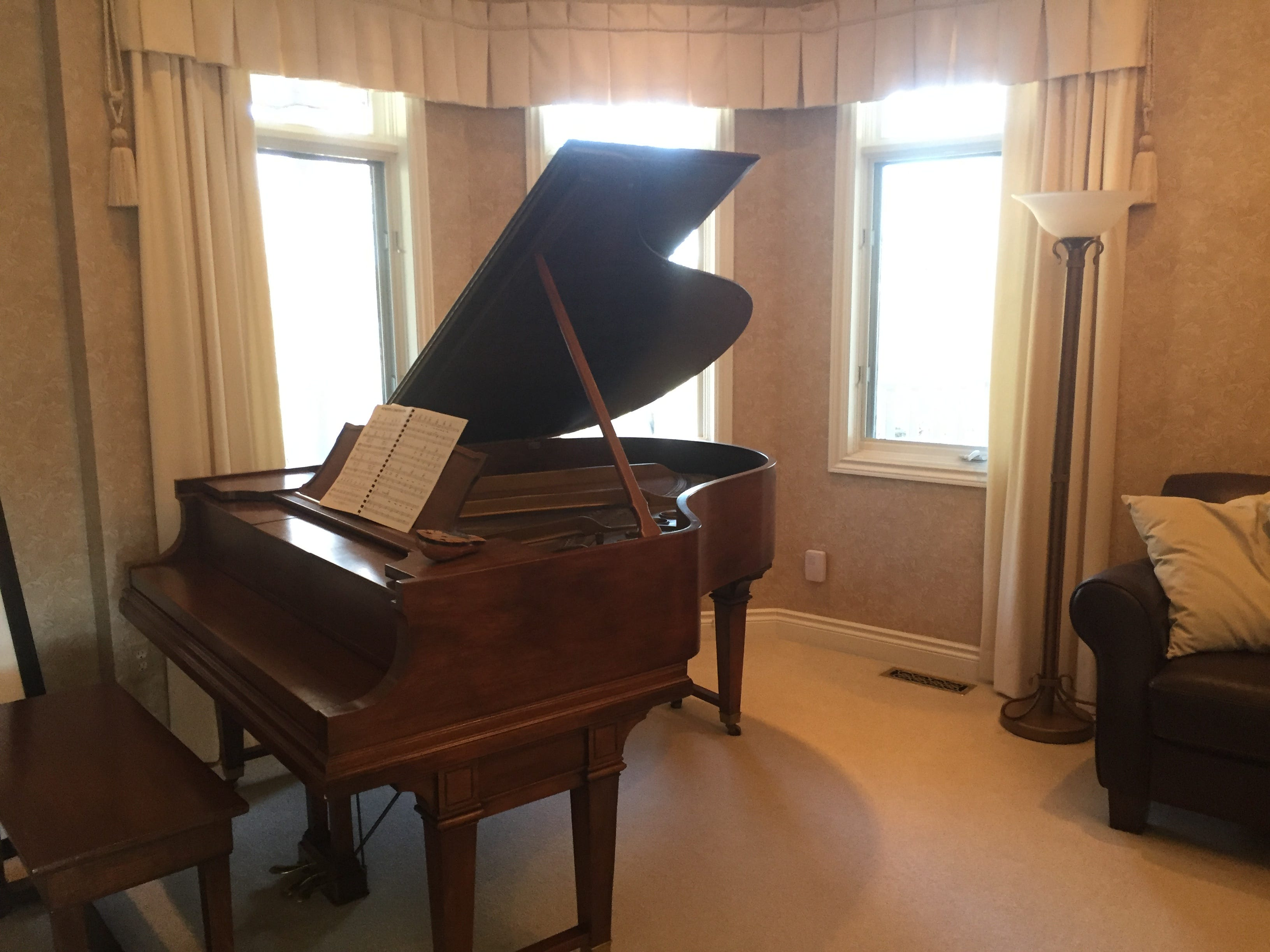 A piano sits in a music room in a Clifford Road home in Genoa Township, shown Tuesday, Dec. 4, 2018