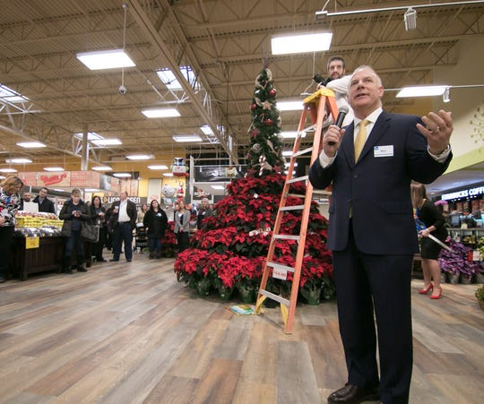 Ken DeLuca, president of Kroger Co. of Michigan, speaks at a ribbon cutting celebrating the Brighton Kroger store's recently completed expansion, Wednesday, Dec. 5, 2018.