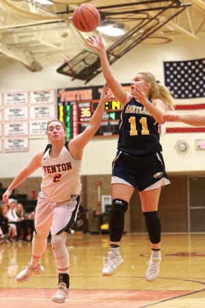 Hartland's Amanda Roach takes a shot while being defended by Fenton's Samantha Whaling in the Eagles' 61-37 victory on Tuesday, Dec. 4, 2018.