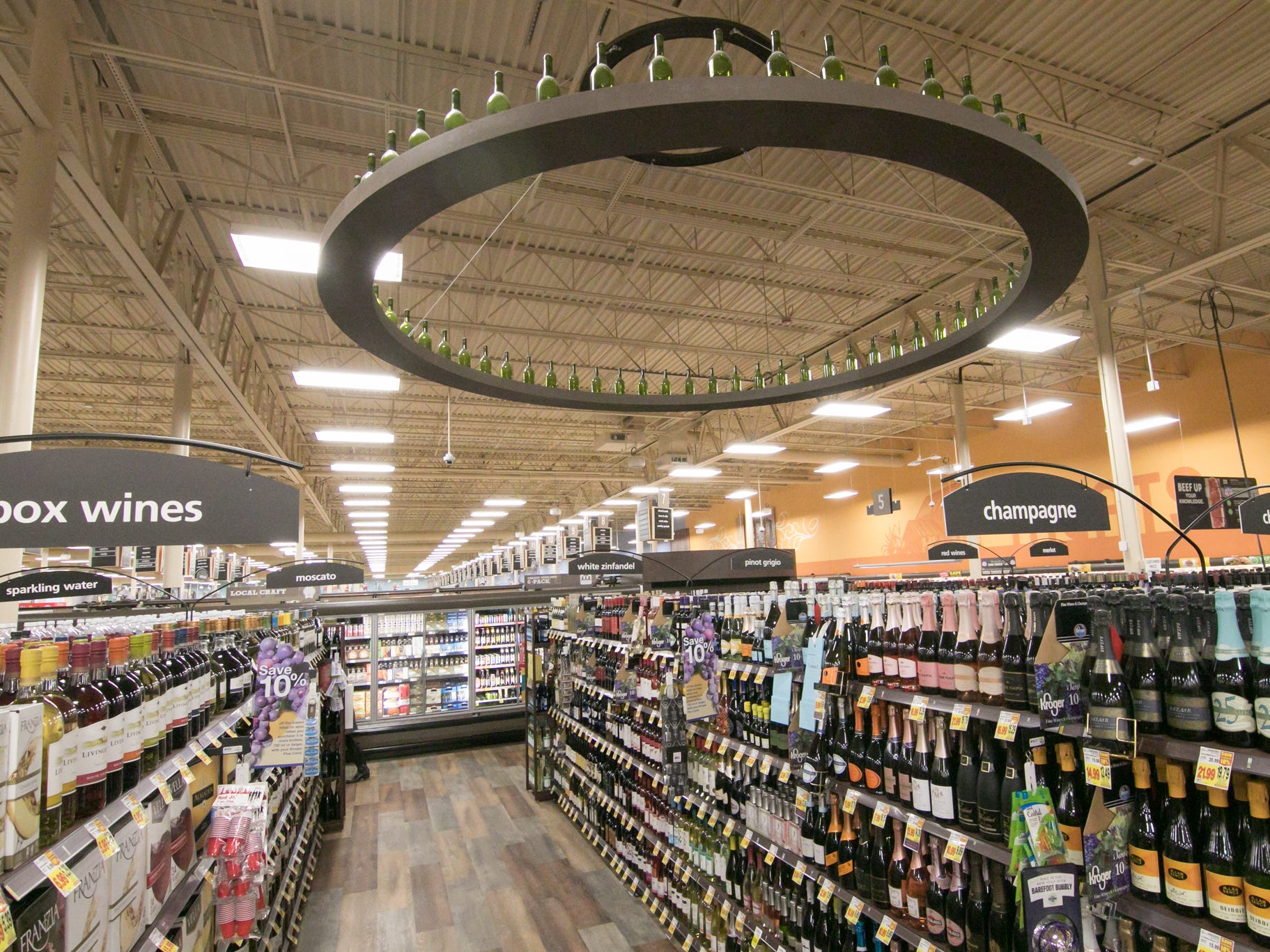The wine department at the Brighton Kroger store, celebrating its expansion Wednesday, Dec. 5, 2018, has more room for its vast selection.