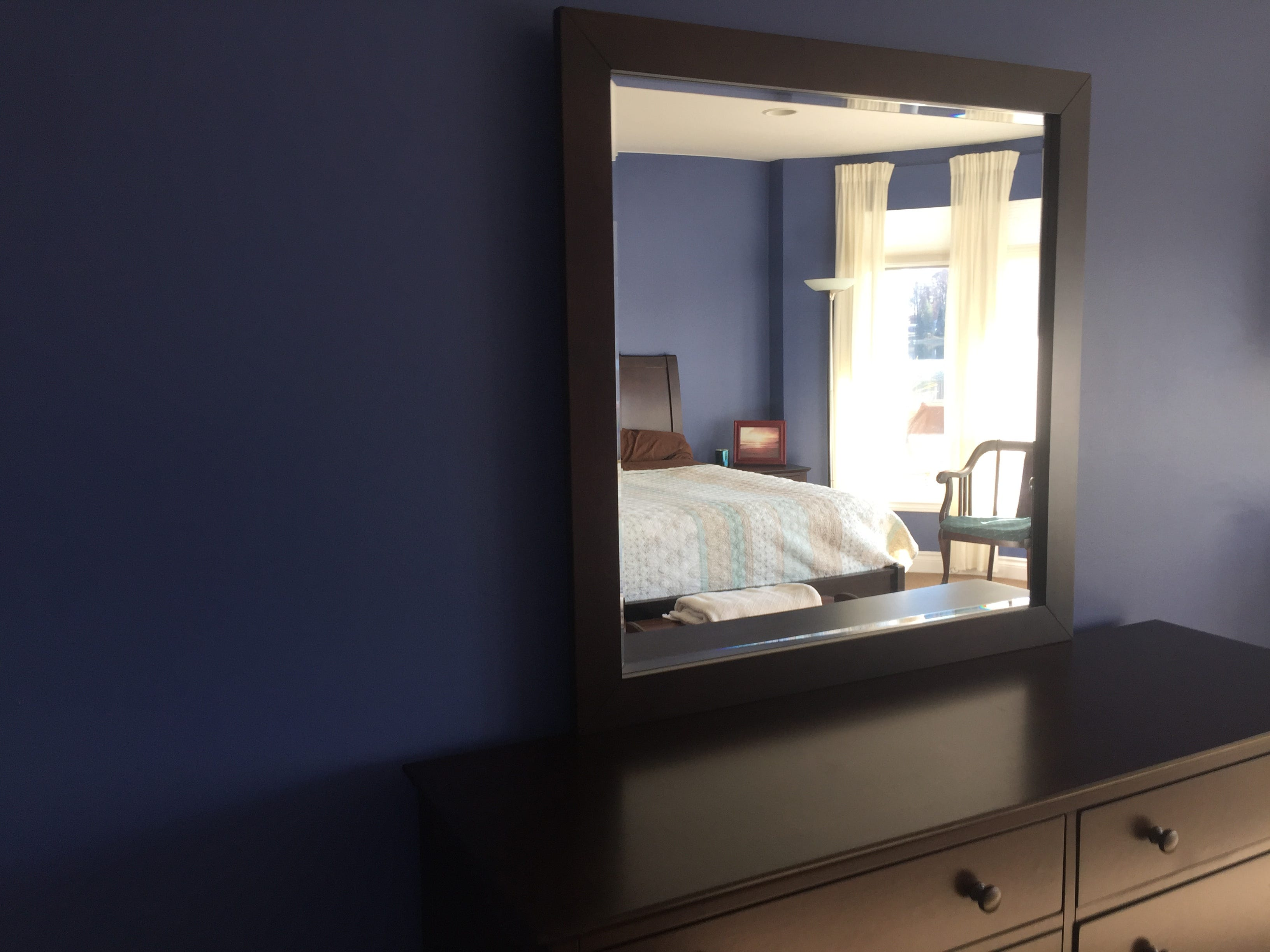 A glimpse of a guest room on the lower-level walk-out basement is seen in a mirror in a Clifford Road home in Genoa Township Tuesday, Dec. 4, 2018